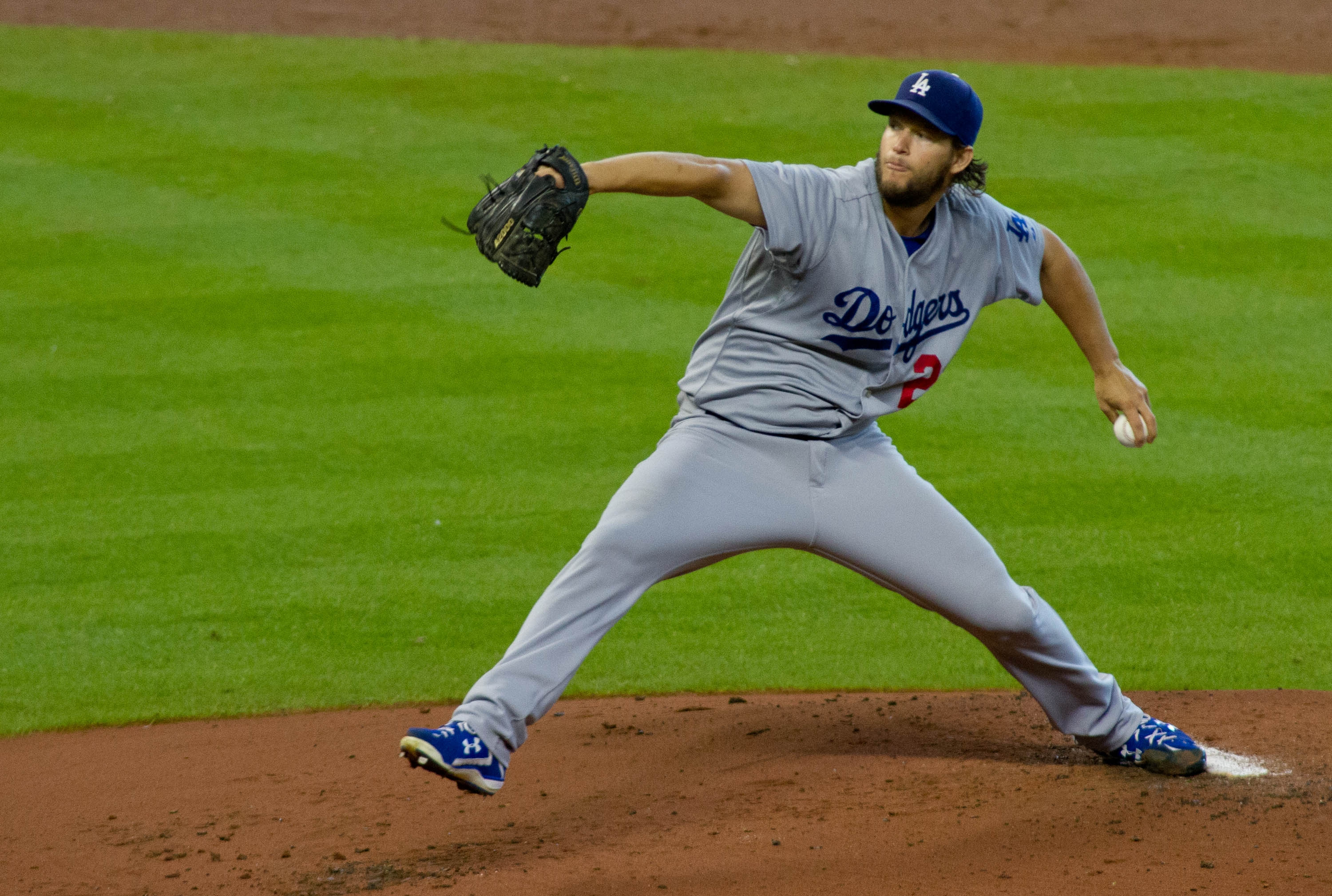 Los Angeles Dodgers pitcher Clayton Kershaw delivers a pitch against the Houston Astros in the first inning of a baseball game Sunday, Aug. 23, 2015, in Houston.  (AP Photo/Richard Carson)