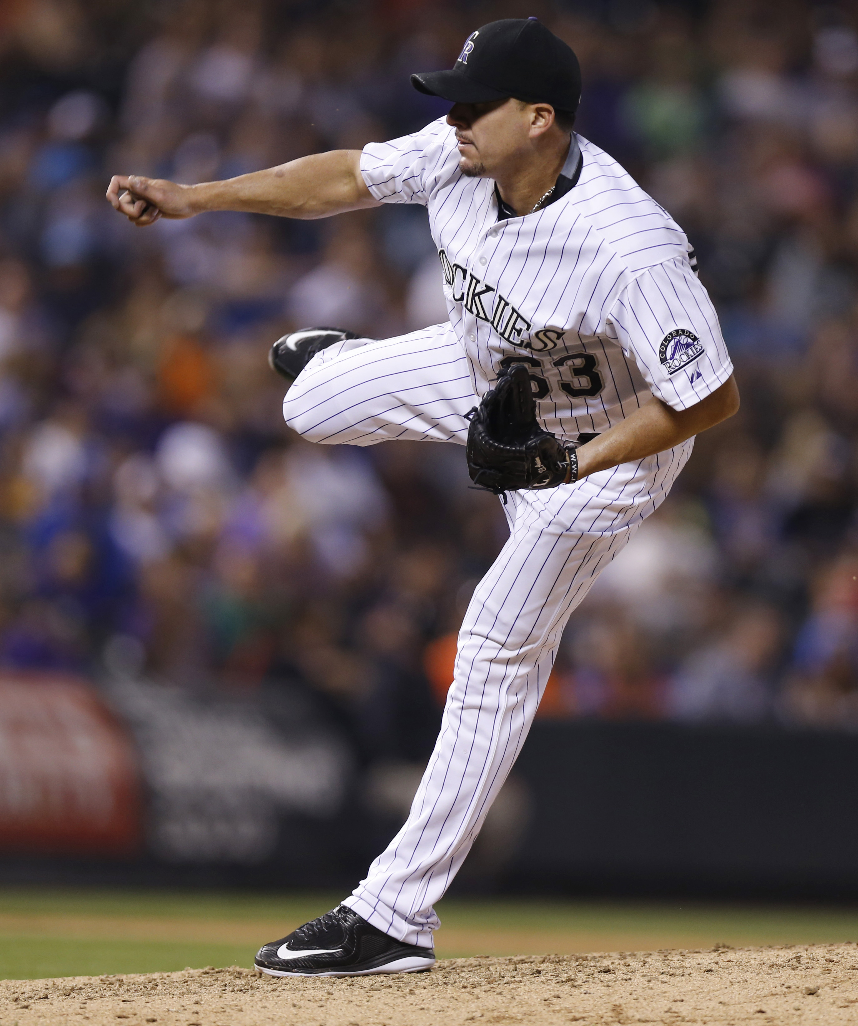 In this Saturday, Aug. 22, 2015, photo, Colorado Rockies relief pitcher Rafael Betancourt works against the New York Mets during the seventh inning of a baseball game in Denver. Betancourt was designated for assignment Sunday, Aug. 23. (AP Photo/David Zal
