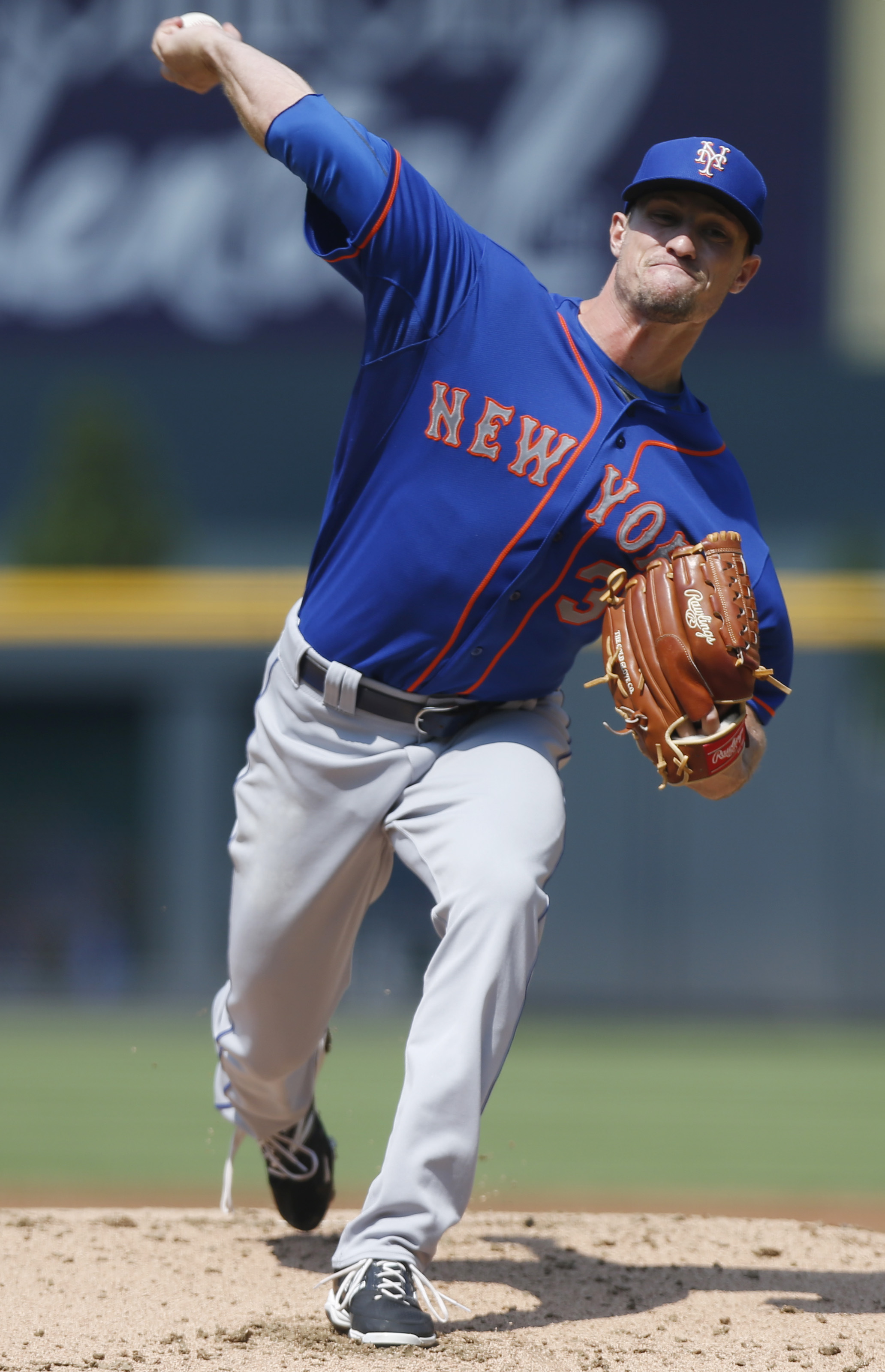 New York Mets starting pitcher Logan Verrett works against the Colorado Rockies during the first inning of a baseball game Sunday, Aug. 23, 2015, in Denver. (AP Photo/David Zalubowski)