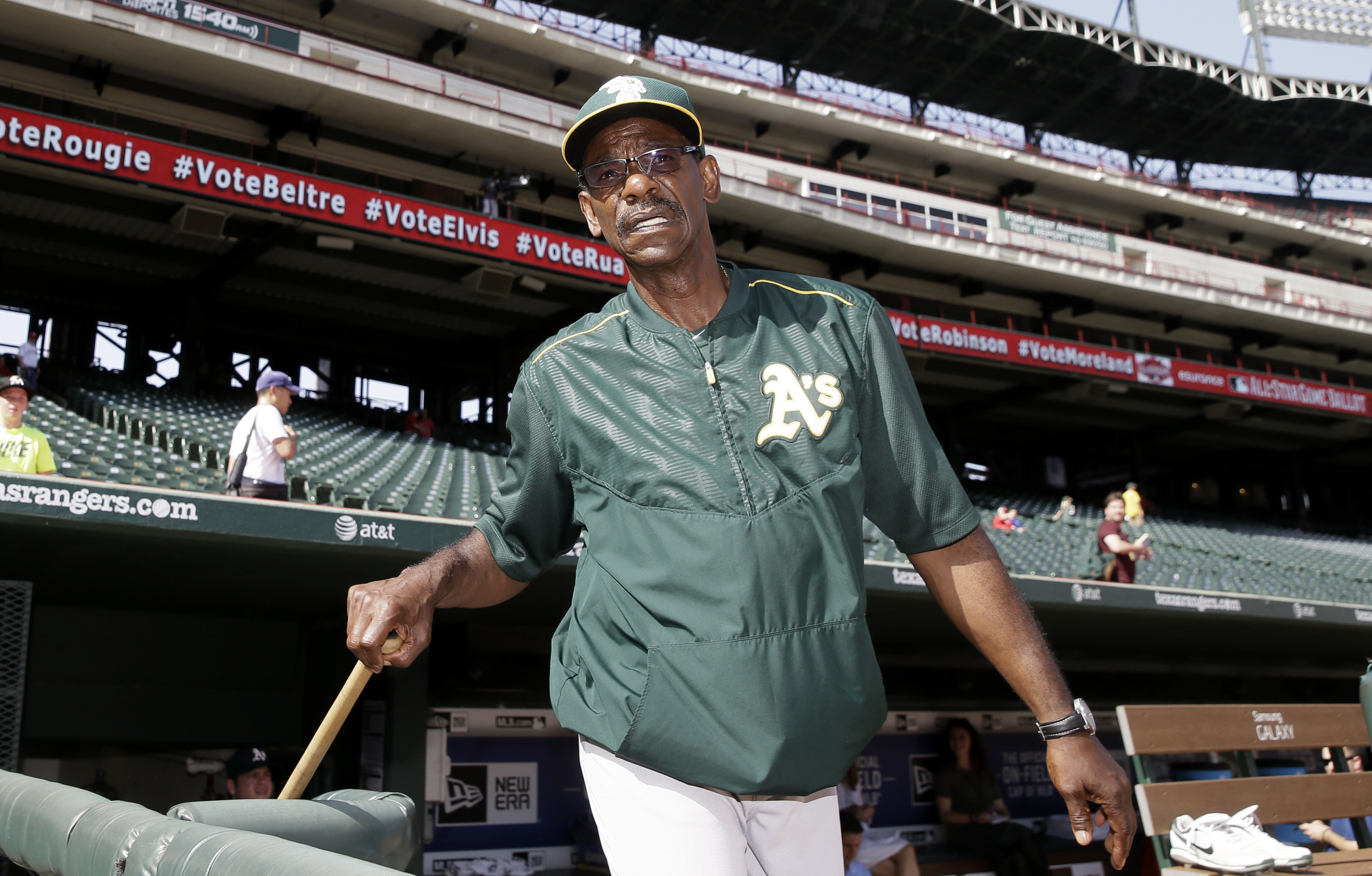 FILE - In this June 23, 2015, file photo, Oakland Athletics fielding coach Ron Washington walks out of the visitors dugout for a workout with players before a baseball game against the Texas Rangers in Arlington, Texas. Washington is back in the dugout wh