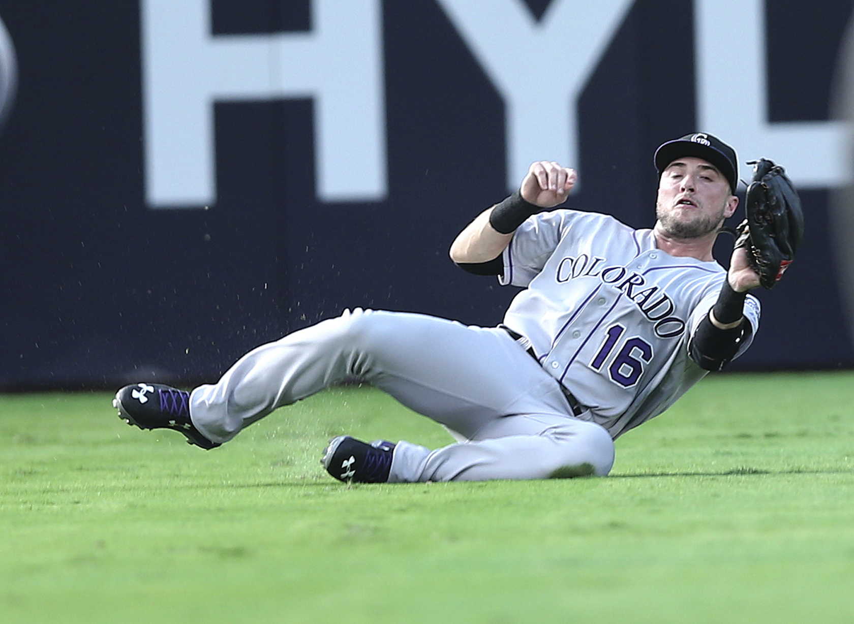 Colorado Rockies left fielder Kyle Parker makes a sliding catch to retire Atlanta Braves' Adonis Garcia in the second inning of a baseball game Monday, Aug. 24, 2015, in Atlanta. (AP Photo/John Bazemore)
