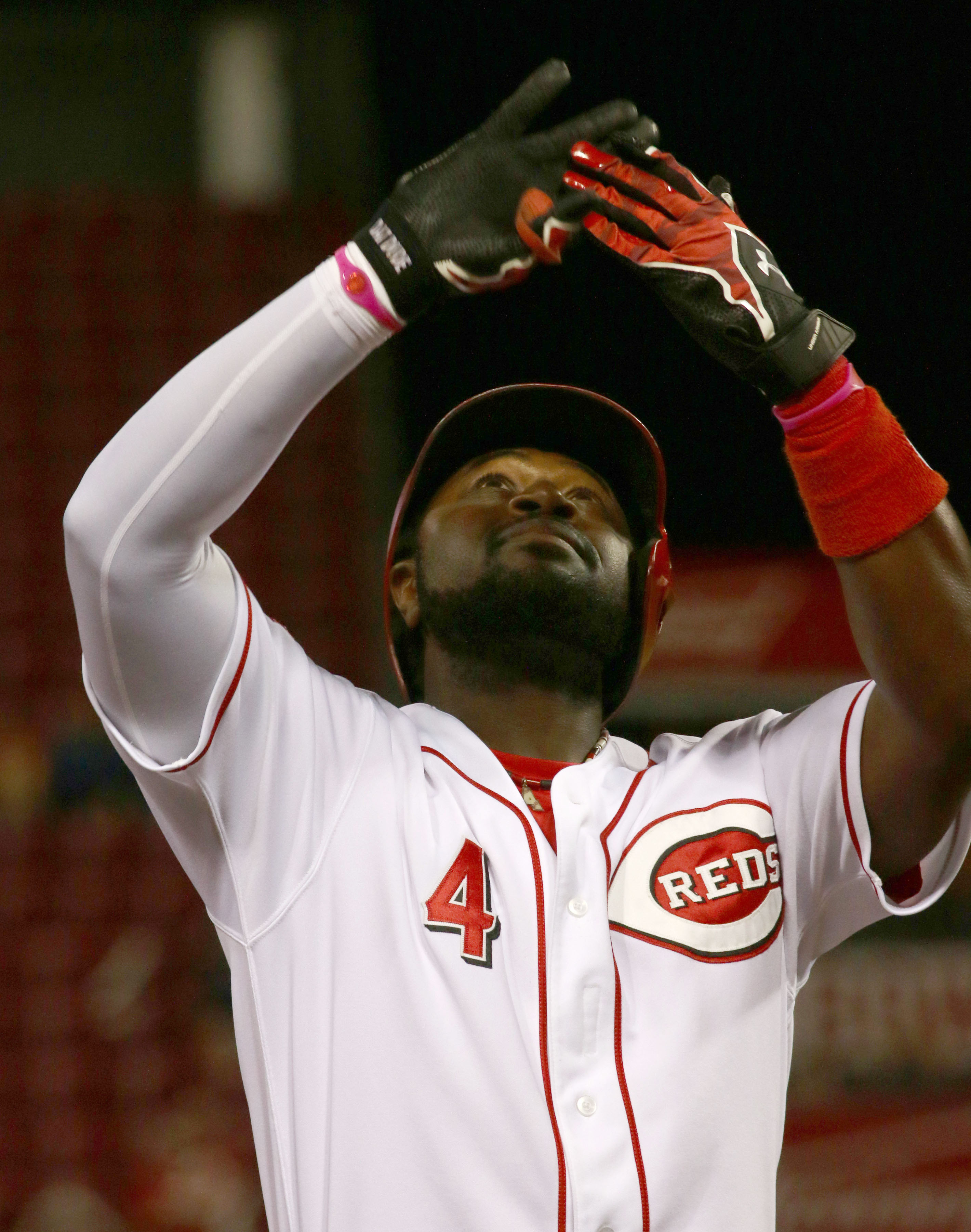 Cincinnati Reds Brandon Phillips reacts after hitting a two-run triple against the Detroit Tigers in the sixth inning of their baseball game in Cincinnati, Monday Aug. 24, 2015. (AP Photo/Tom Uhlman)