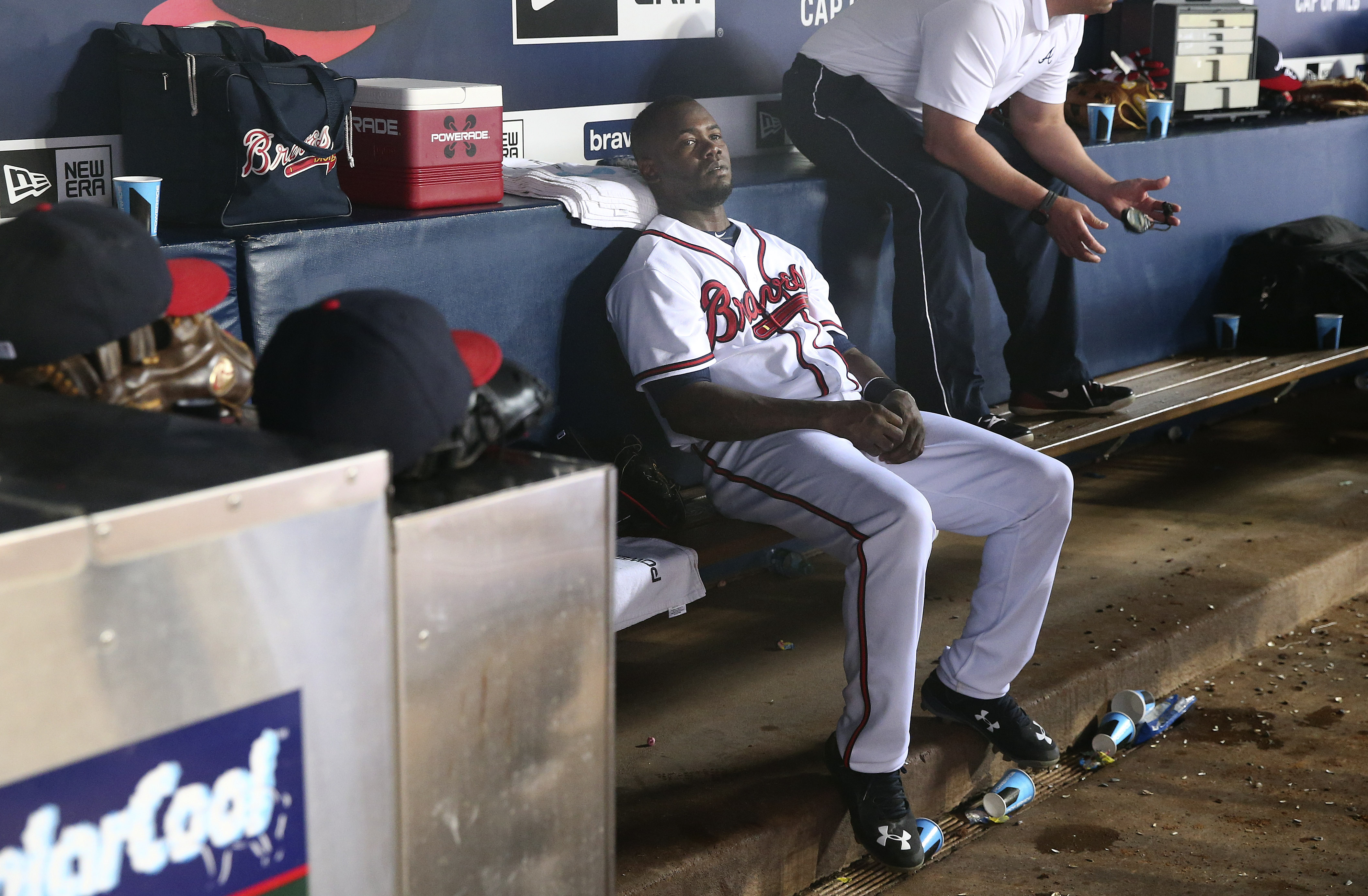 Atlanta Braves third baseman Adonis Garcia sits on the bench in ninth inning of a baseball game against the Colorado Rockies, Tuesday, Aug. 25, 2015, in Atlanta. Colorado won 5-1. (AP Photo/John Bazemore)