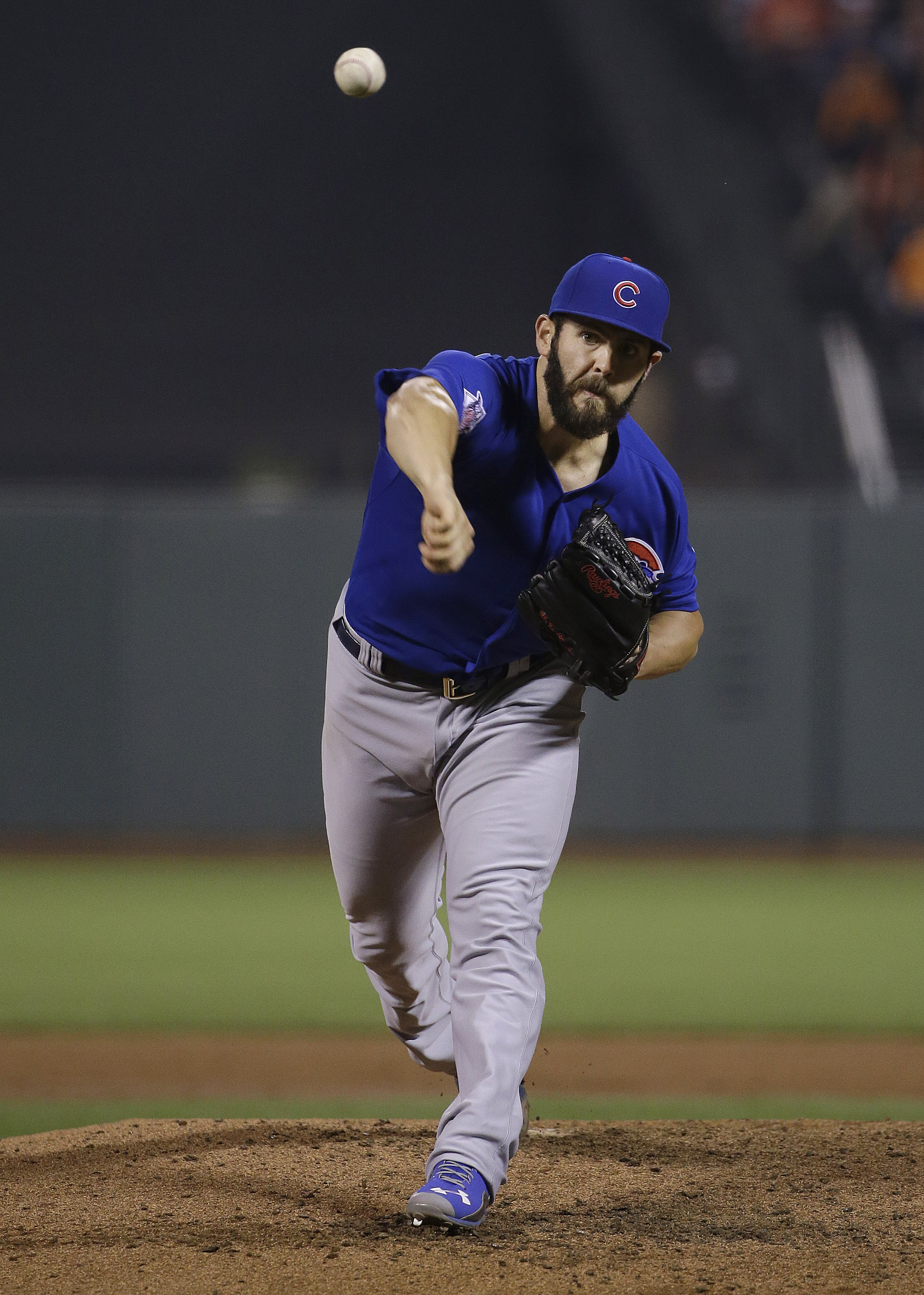Chicago Cubs pitcher Jake Arrieta throws against the San Francisco Giants during the fourth inning of a baseball game in San Francisco, Tuesday, Aug. 25, 2015. (AP Photo/Jeff Chiu)