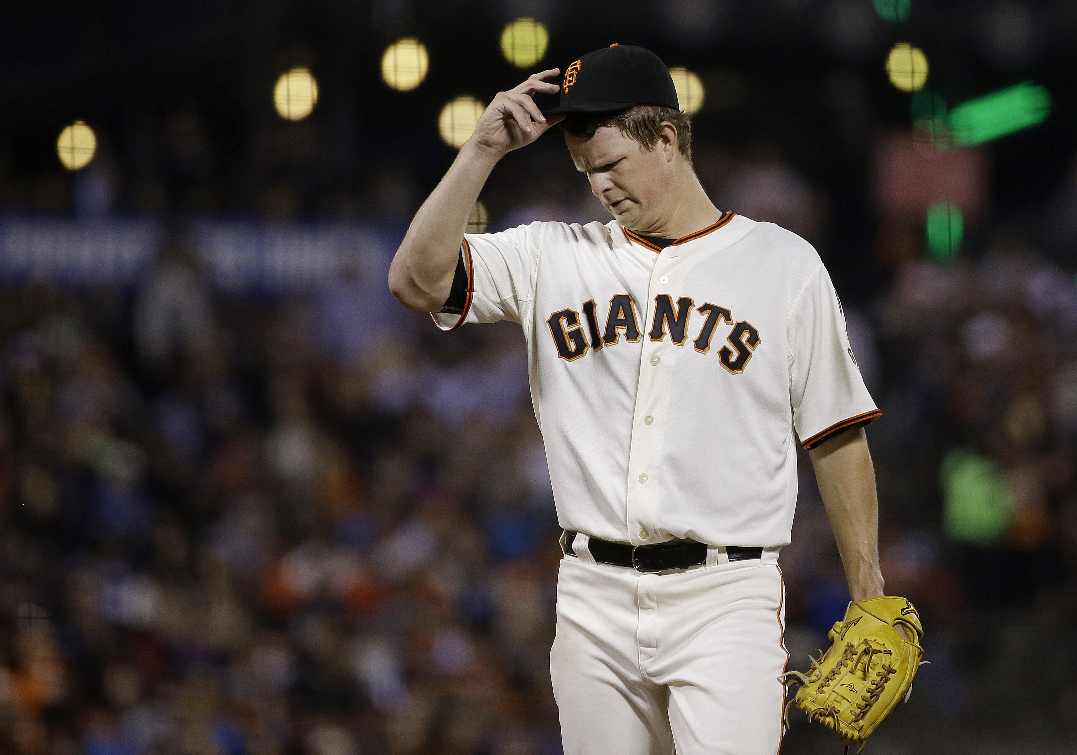 San Francisco Giants pitcher Matt Cain reacts during the fourth inning of a baseball game against the Chicago Cubs in San Francisco, Tuesday, Aug. 25, 2015. (AP Photo/Jeff Chiu)