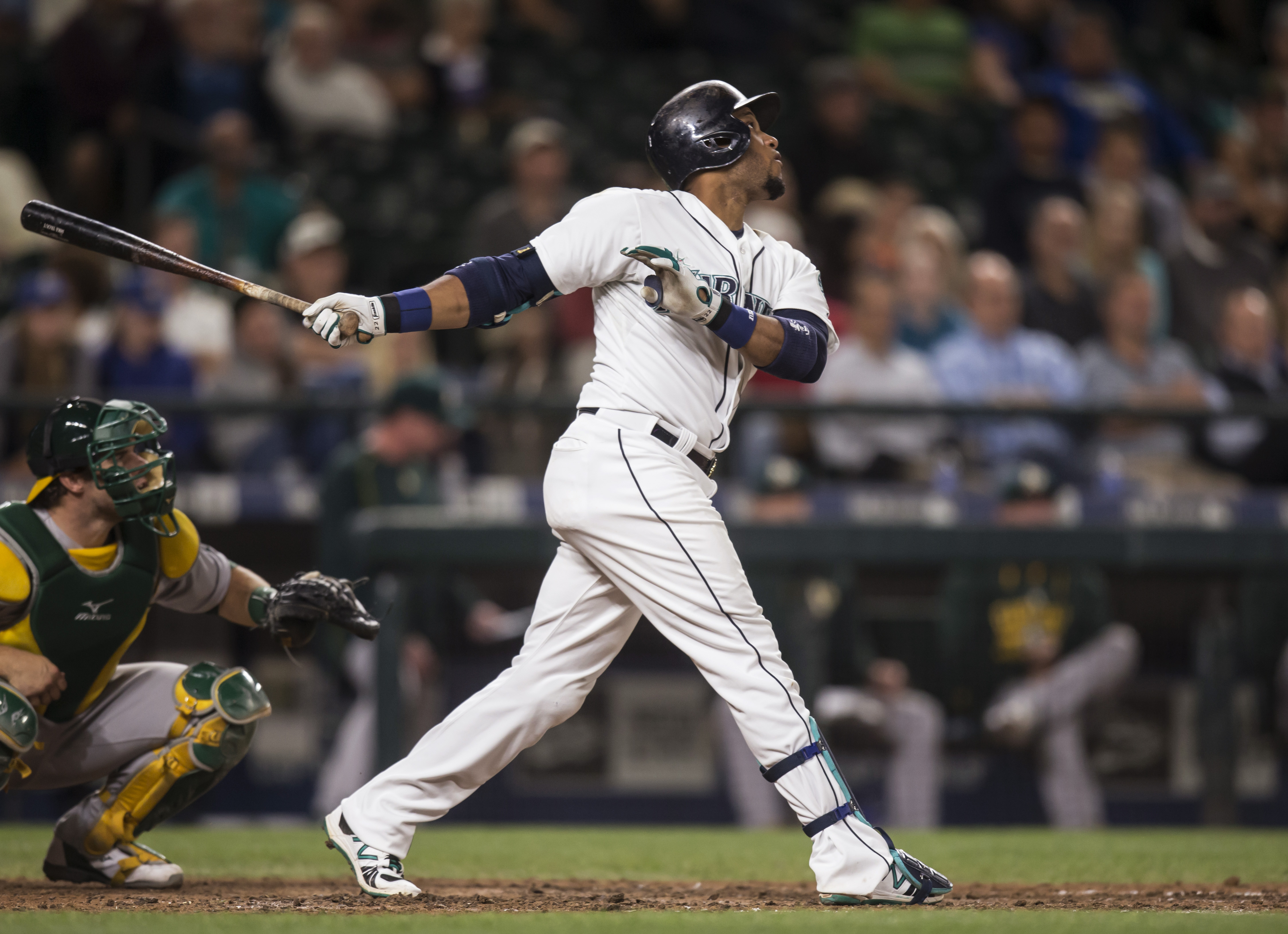 Seattle Mariners' Robinson Cano hits a double during the seventh inning of a baseball game against the Oakland Athletics, Tuesday, Aug. 25, 2015, in Seattle. (AP Photo/Stephen Brashear)
