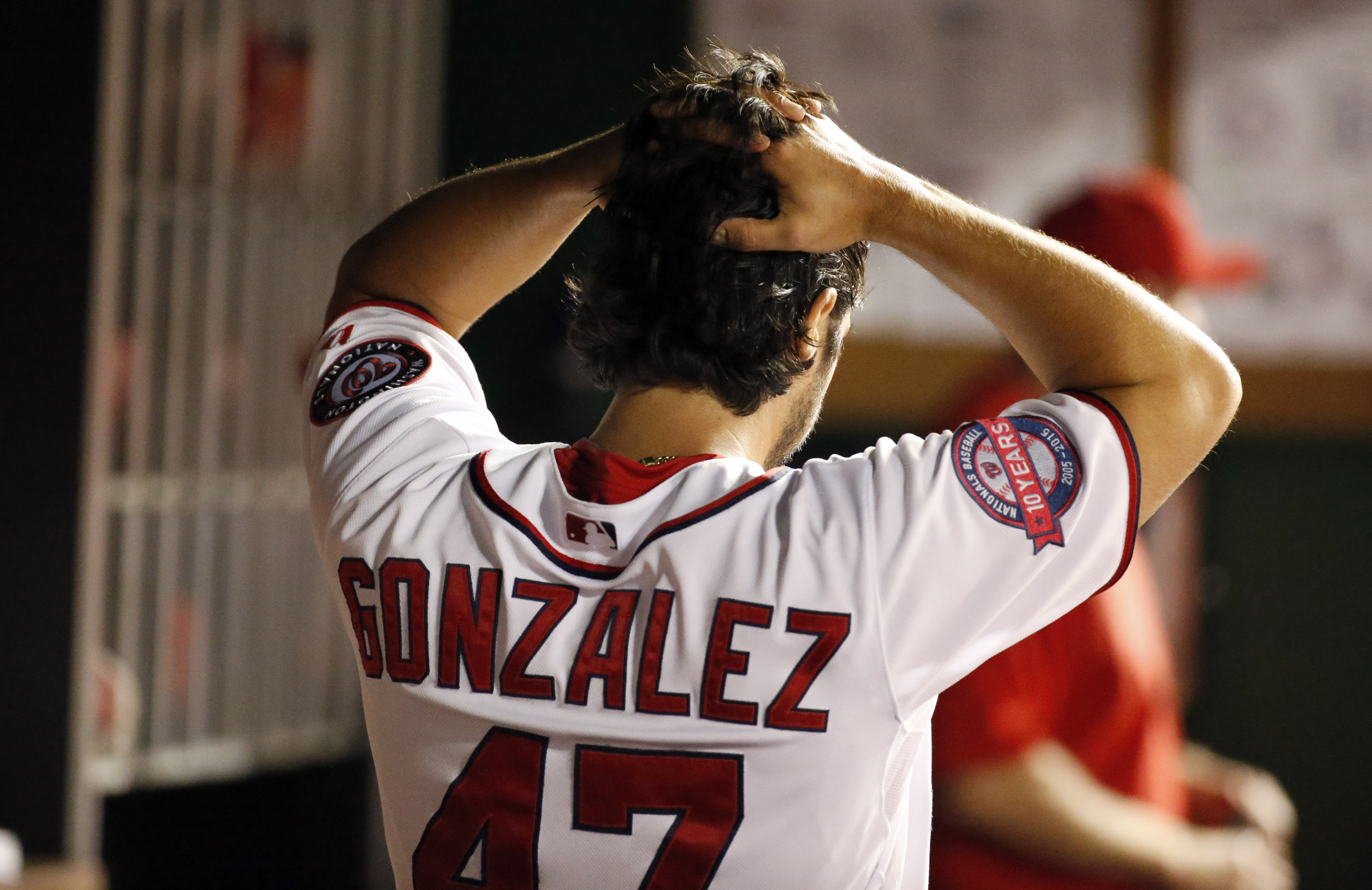 Washington Nationals starting pitcher Gio Gonzalez reacts in the dugout after he was removed during the fifth inning of a baseball game against the San Diego Padres at Nationals Park, Wednesday, Aug. 26, 2015, in Washington. (AP Photo/Alex Brandon)