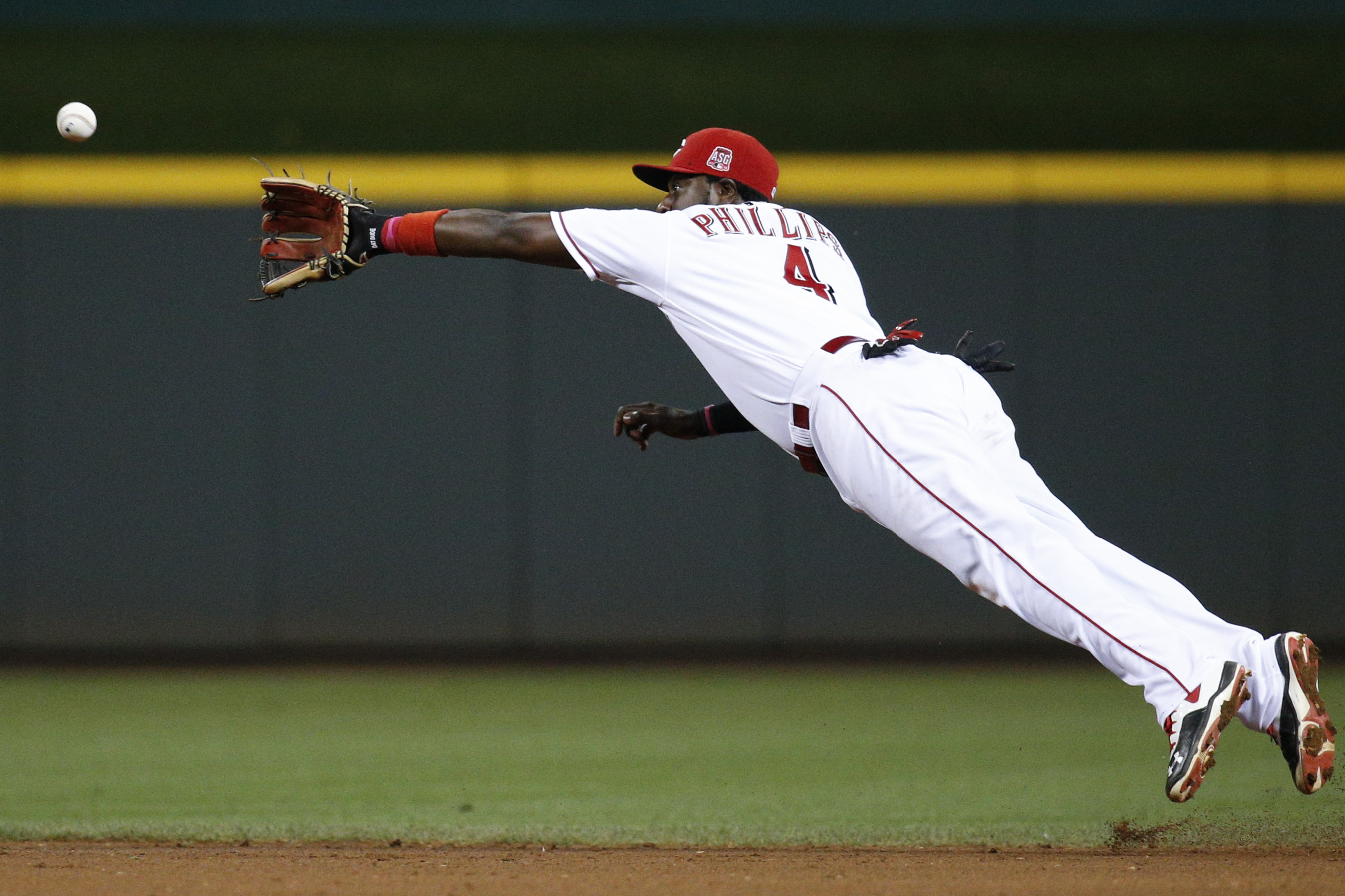 "Cincinnati Reds second baseman Brandon Phillips catches a line drive by Los Angeles Dodgers"" Andre Ethier during the eighth inning of a baseball game, Wednesday, Aug. 26, 2015, in Cincinnati. (AP Photo/John Minchillo)"