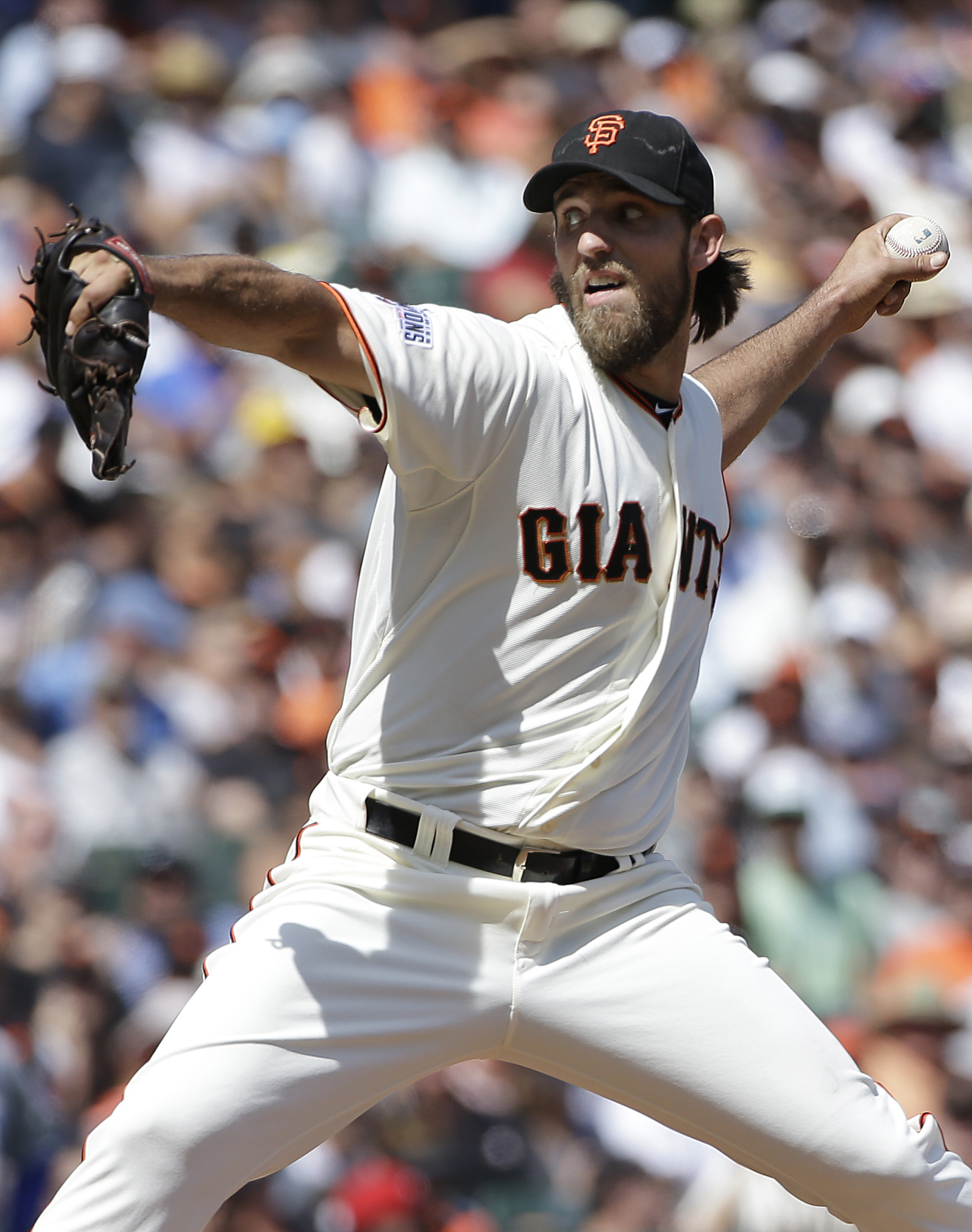 San Francisco Giants pitcher Madison Bumgarner throws against the Chicago Cubs during the sixth inning of a baseball game in San Francisco, Thursday, Aug. 27, 2015. (AP Photo/Jeff Chiu)
