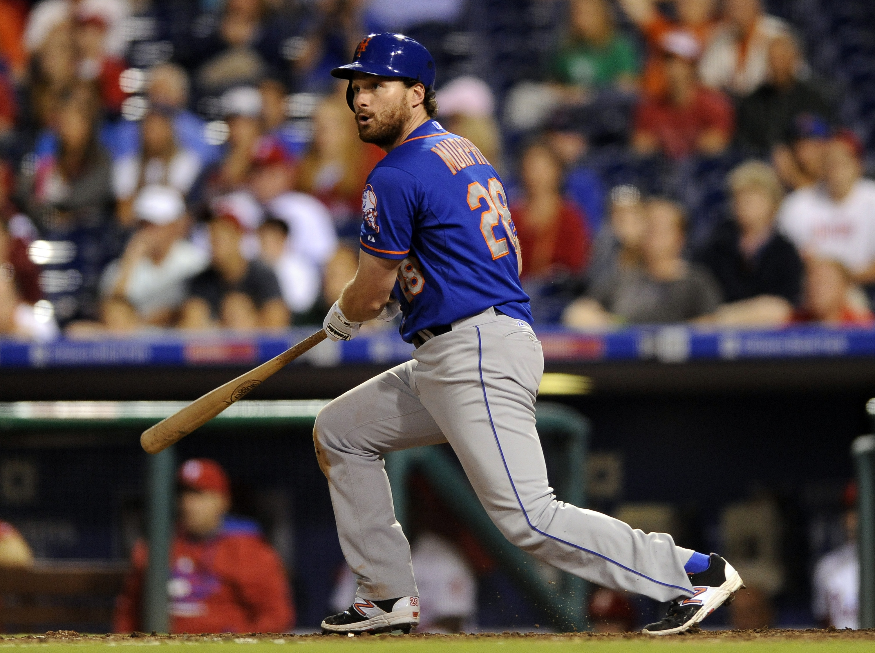 New York Mets' Daniel Murphy watches a two-run double in the 13th inning of a baseball game against the Philadlephia Phillies, Thursday, Aug. 27, 2015, in Philadelphia. The Mets won 9-5. (AP Photo/Michael Perez)