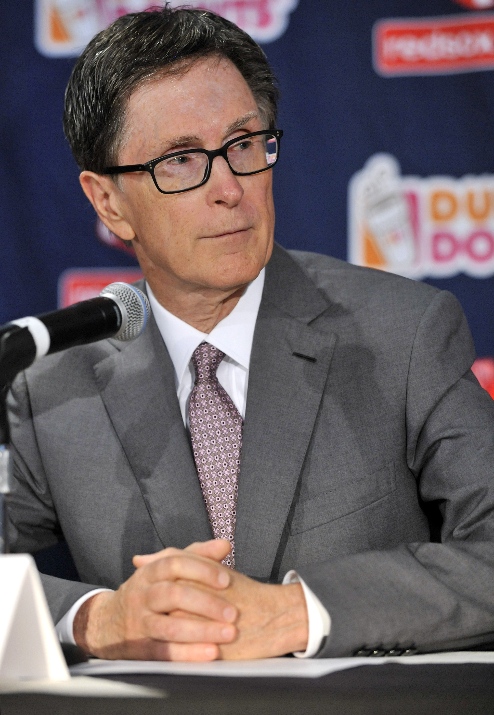 Red Sox Owner John Henry responds to a reporter's question during a news conference where Dave Dombrowski was introduced at Fenway Park as the new Boston Red Sox president of baseball operations Wednesday, Aug. 19, 2015, in Boston. (AP Photo/Josh Reynolds