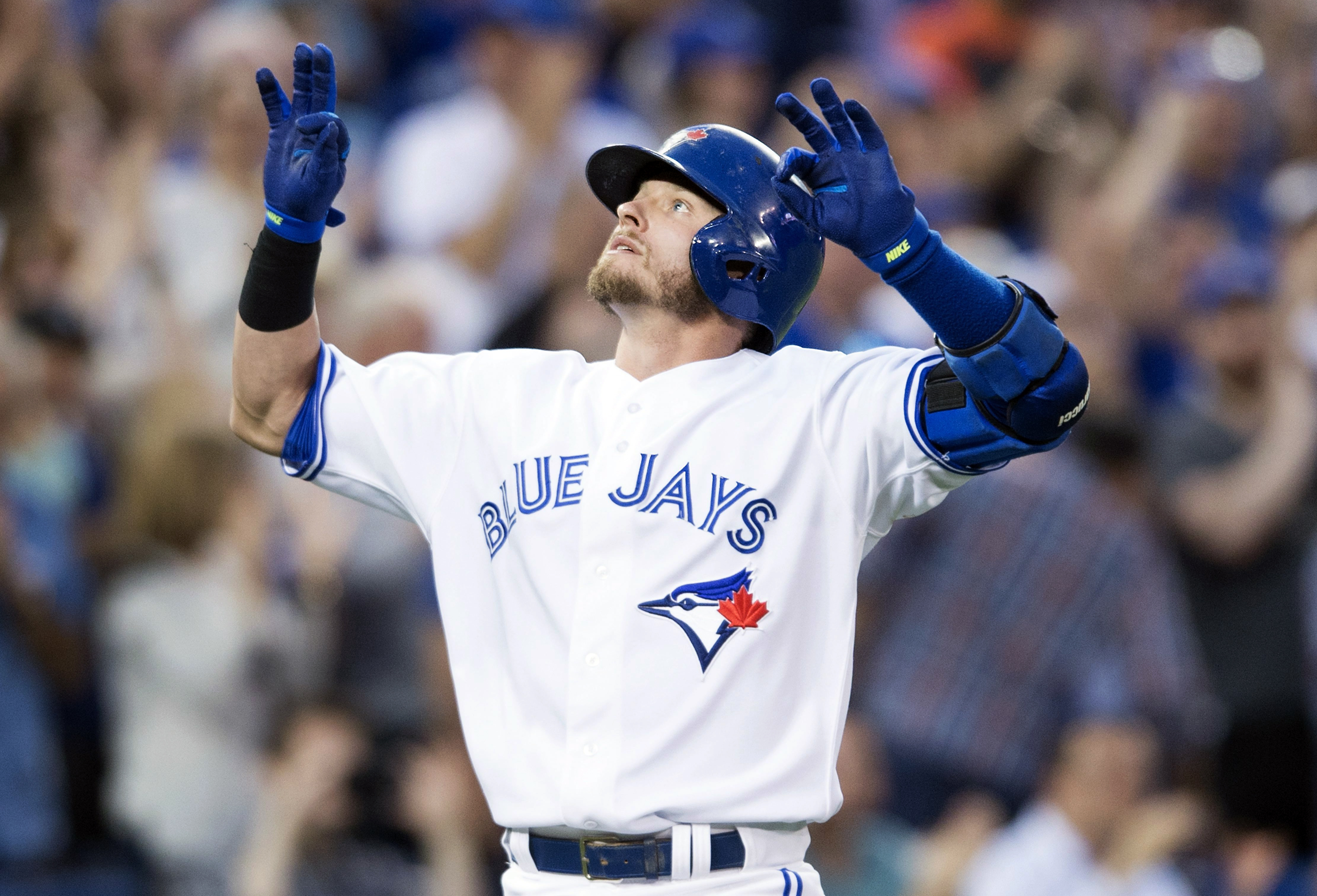 Toronto Blue Jays' Josh Donaldson celebrates a solo home run during third-inning baseball game action against the Detroit Tigers in Toronto, Friday, Aug. 28, 2015. (Darren Calabrese/The Canadian Press via AP) MANDATORY CREDIT