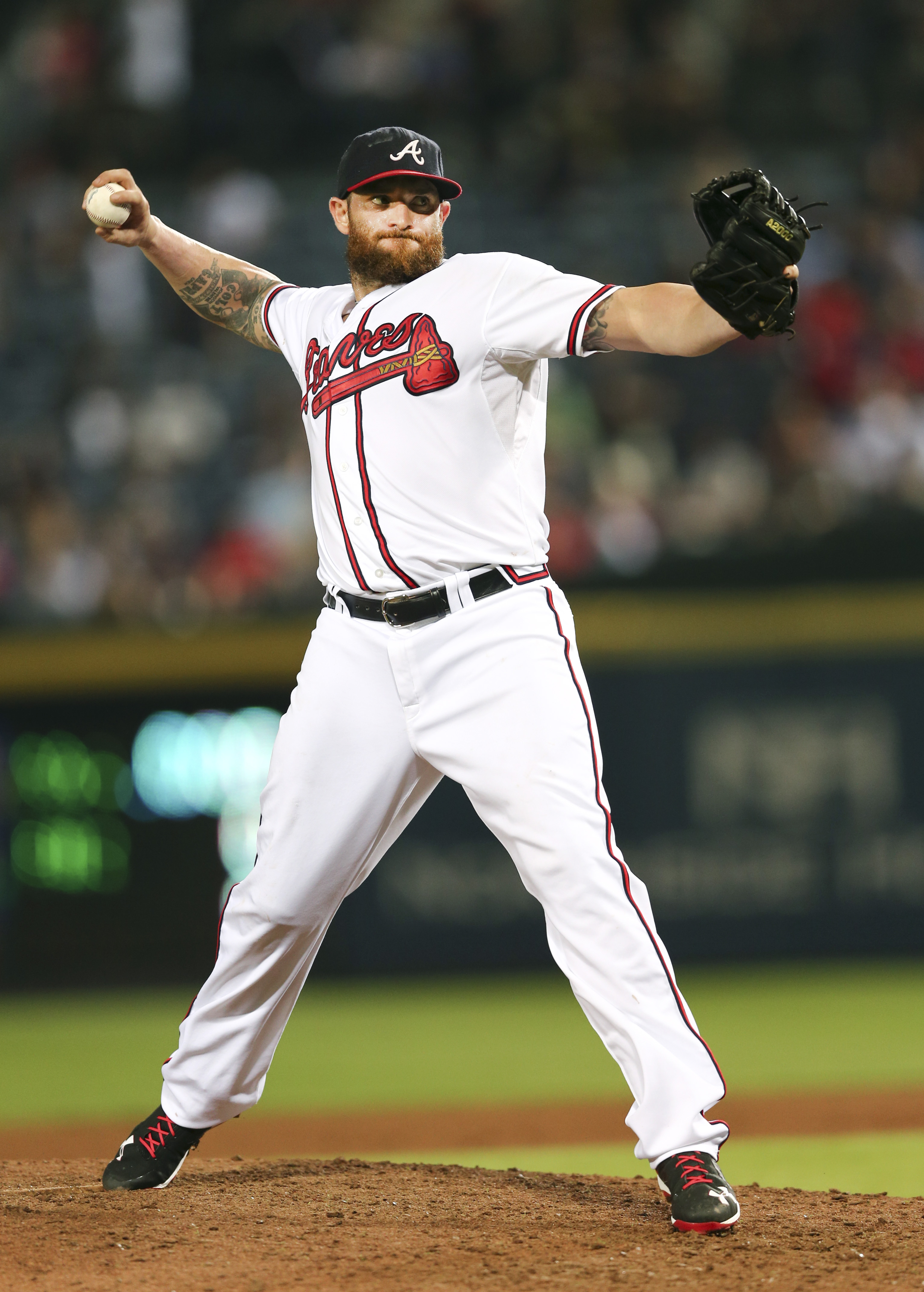 Atlanta Braves' Jonny Gomes pitches in relief in the ninth inning of a baseball game against the New York Yankees, Friday, Aug. 28, 2015, in Atlanta. (AP Photo/John Bazemore)