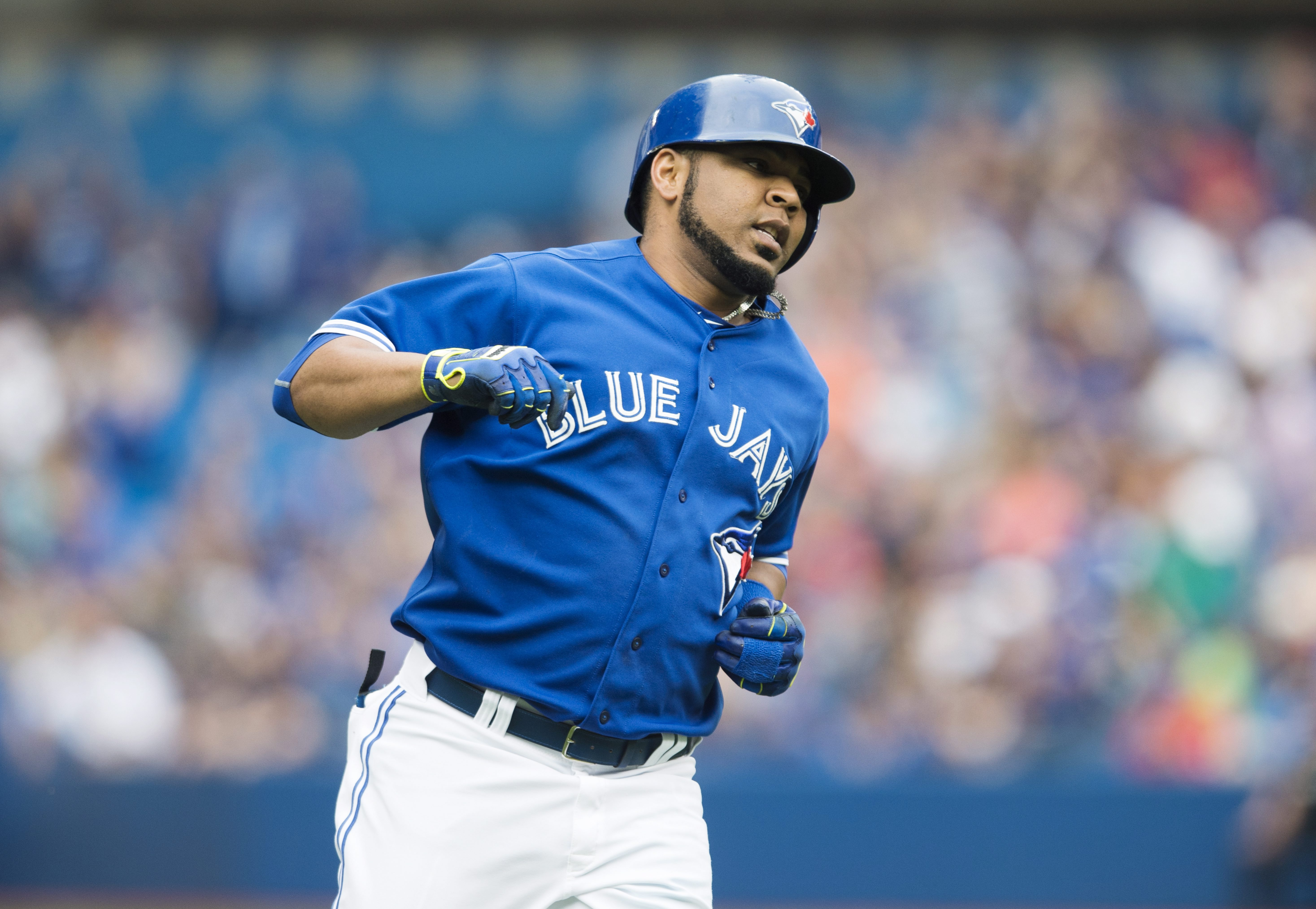 Toronto Blue Jays' Edwin Encarnacion rounds the bases following a three-run home run during the first inning of a baseball game against the Detroit Tigers in Toronto on Saturday, Aug. 29, 2015. (Darren Calabrese/The Canadian Press via AP) MANDATORY CREDIT
