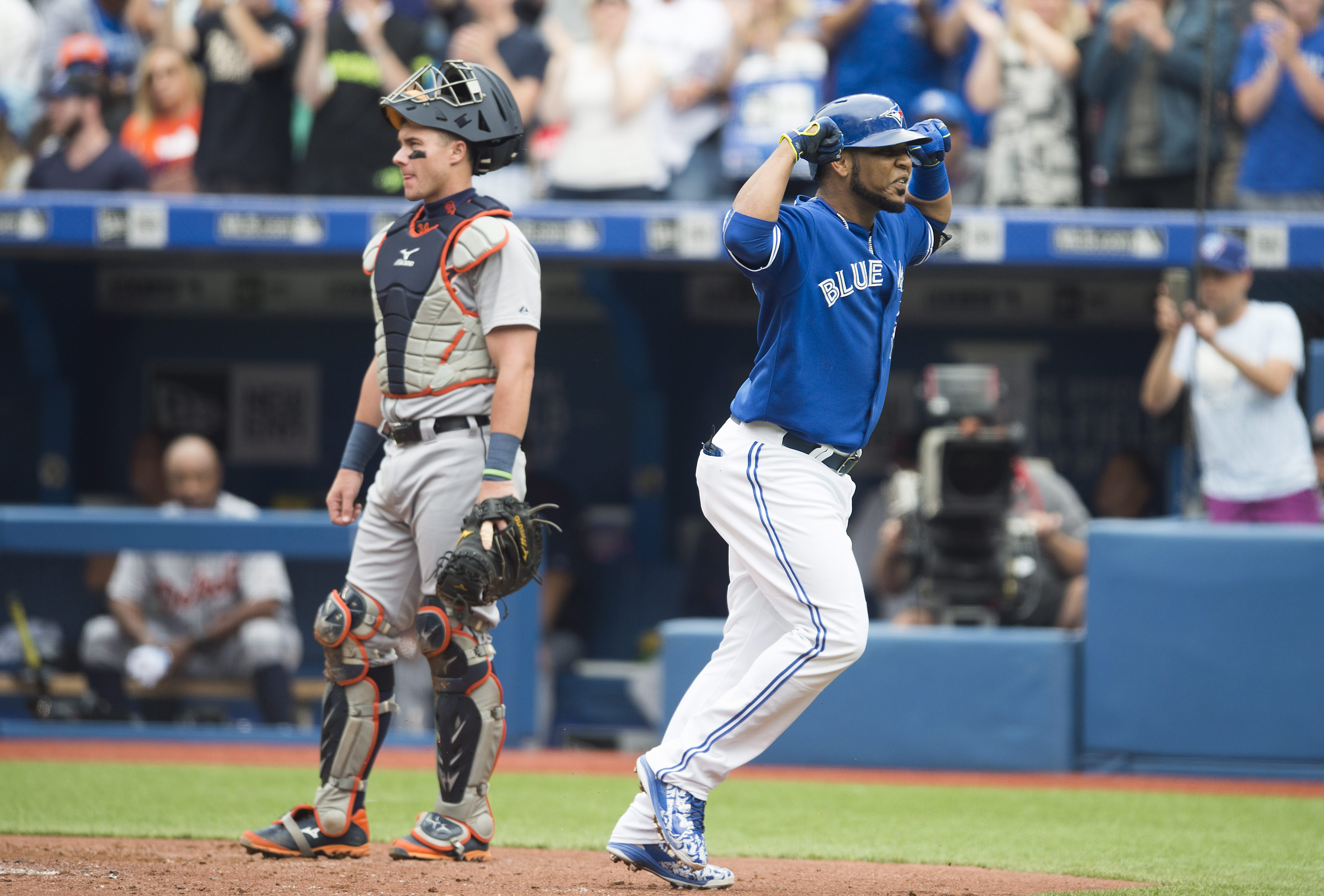 Toronto Blue Jays' Edwin Encarnacion, right, celebrates a three-run home run in front of Detroit Tigers' catcher James McCann during the first inning of a baseball game in Toronto on Saturday, Aug. 29, 2015. (Darren Calabrese/The Canadian Press via AP) MA