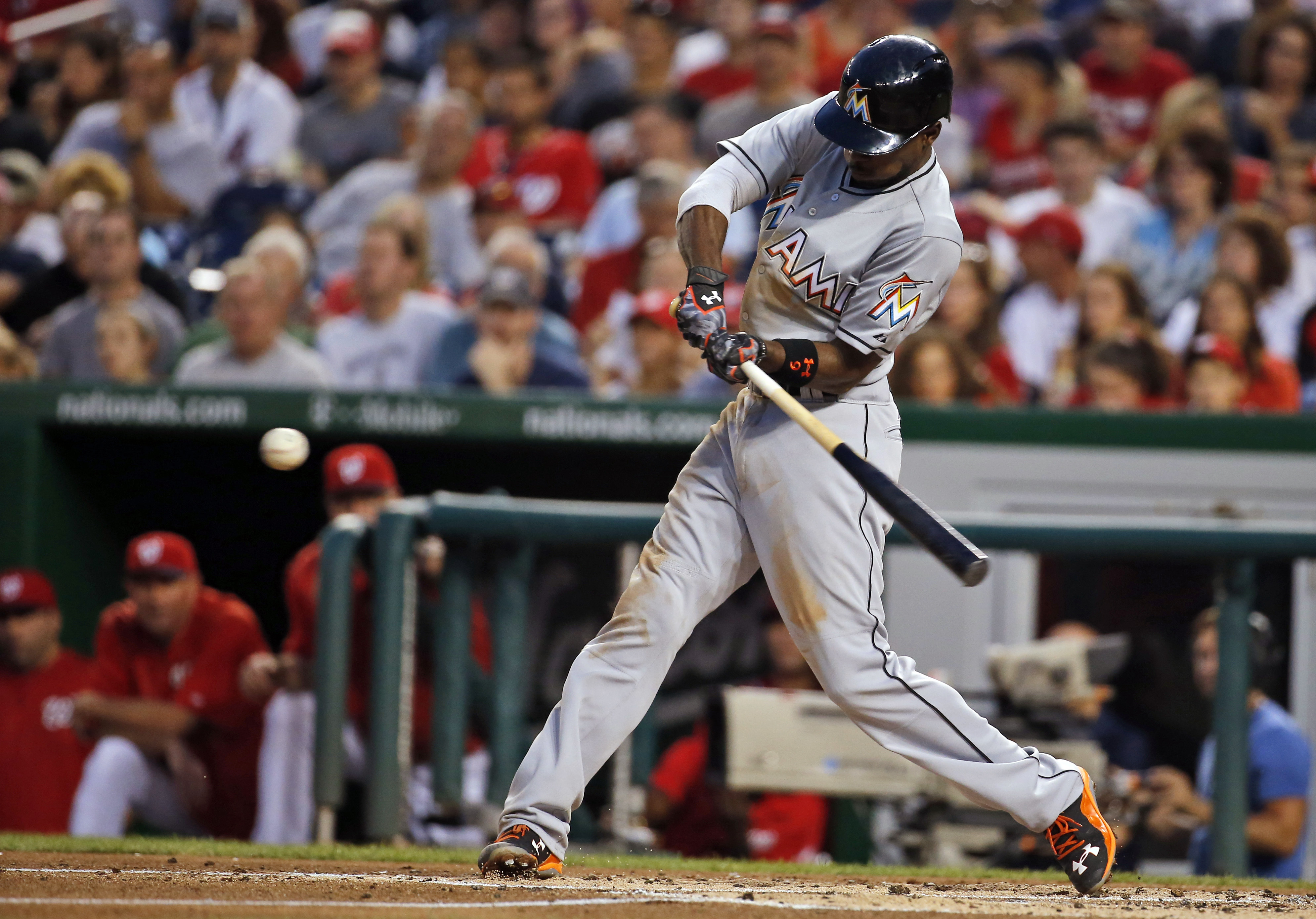 Miami Marlins' Dee Gordon hits a double during the third inning of a baseball game against the Washington Nationals at Nationals Park, Saturday, Aug. 29, 2015, in Washington.  (AP Photo/Alex Brandon)