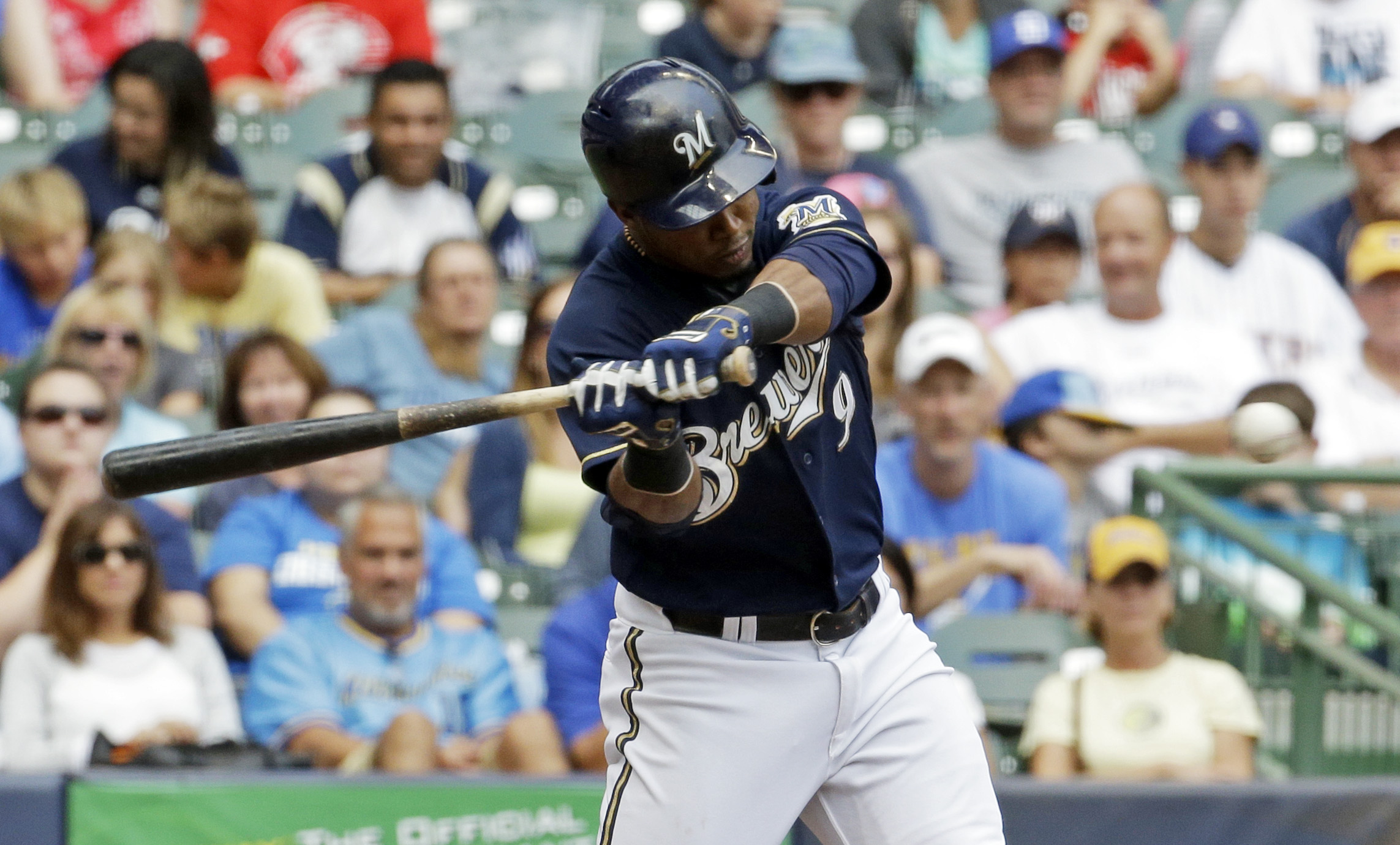 Milwaukee Brewers' Jean Segura hits an RBI triple during the eighth inning of a baseball game against the Cincinnati Reds Sunday, Aug. 30, 2015, in Milwaukee. (AP Photo/Morry Gash)