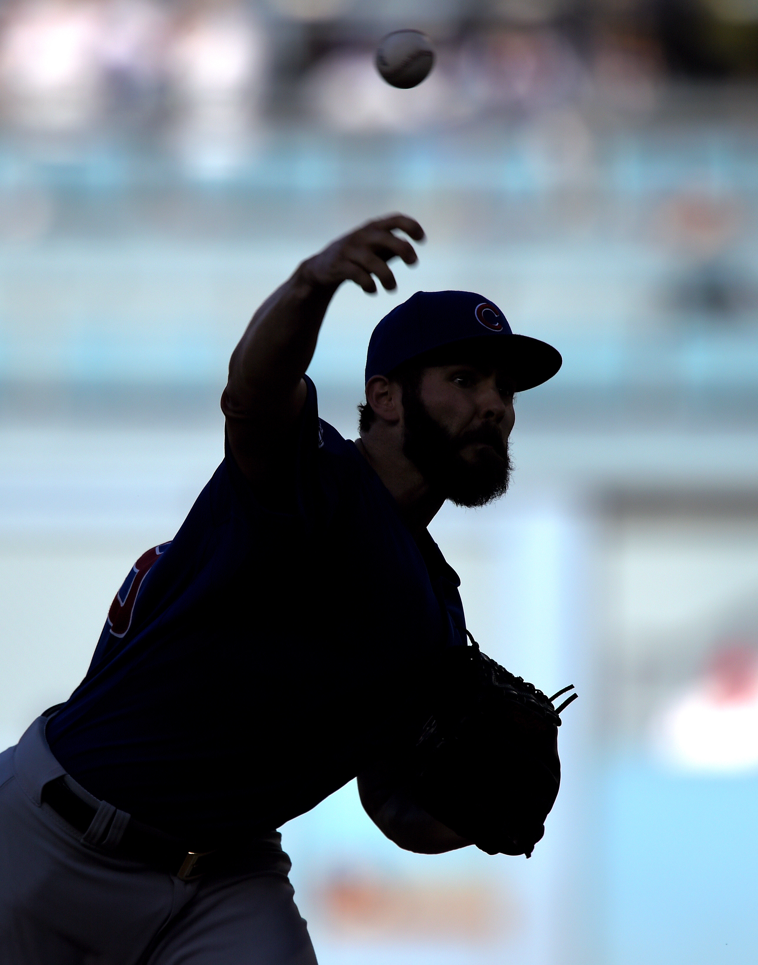 Chicago Cubs starting pitcher Jake Arrieta throws during the first inning of a baseball game against the Los Angeles Dodgers, Sunday, Aug. 30, 2015, in Los Angeles. (AP Photo/Mark J. Terrill)