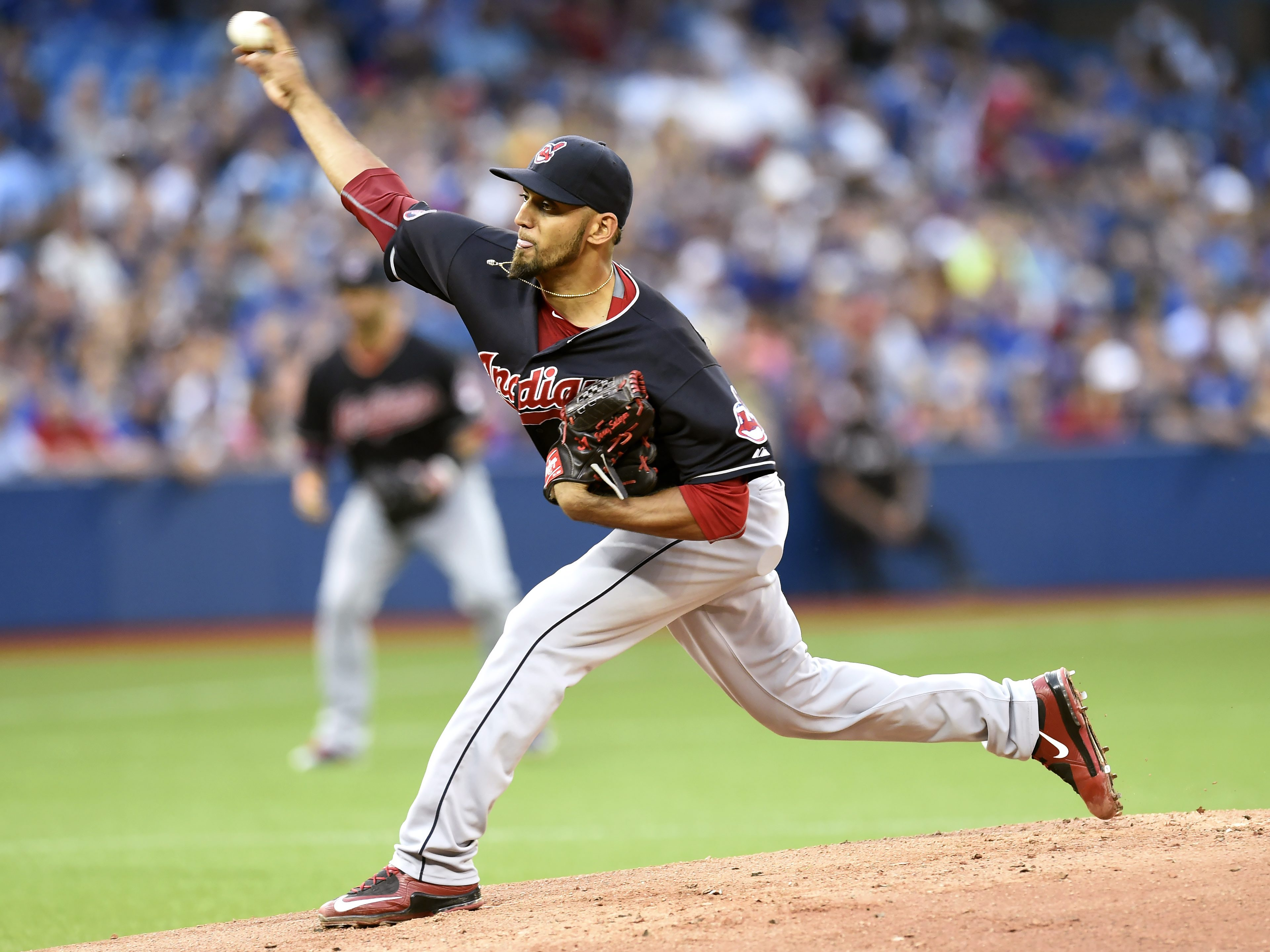 Cleveland Indians' starting pitcher Danny Salazar works against the Toronto Blue Jays during the first inning of a baseball game, Monday, Aug. 31, 2015 in Toronto. (Frank Gunn/The Canadian Press via AP) MANDATORY CREDIT