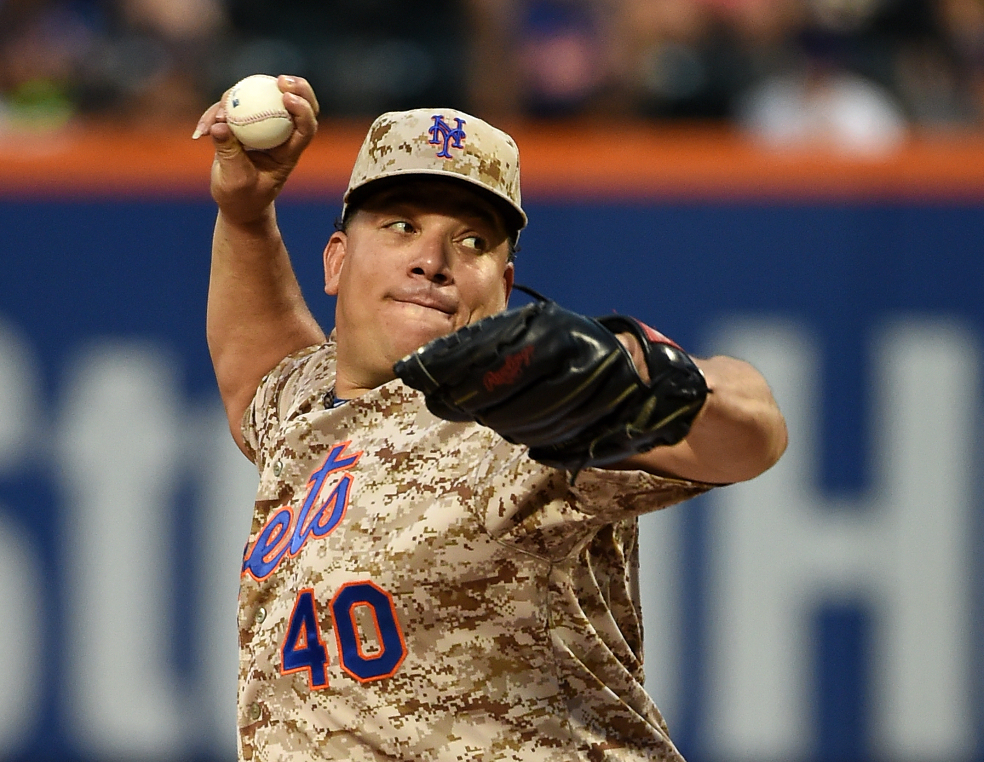 New York Mets starter Bartolo Colon pitches against the Philadelphia Phillies in the first inning of a baseball game at Citi Field on Monday, Aug. 31, 2015, in New York. (AP Photo/Kathy Kmonicek)