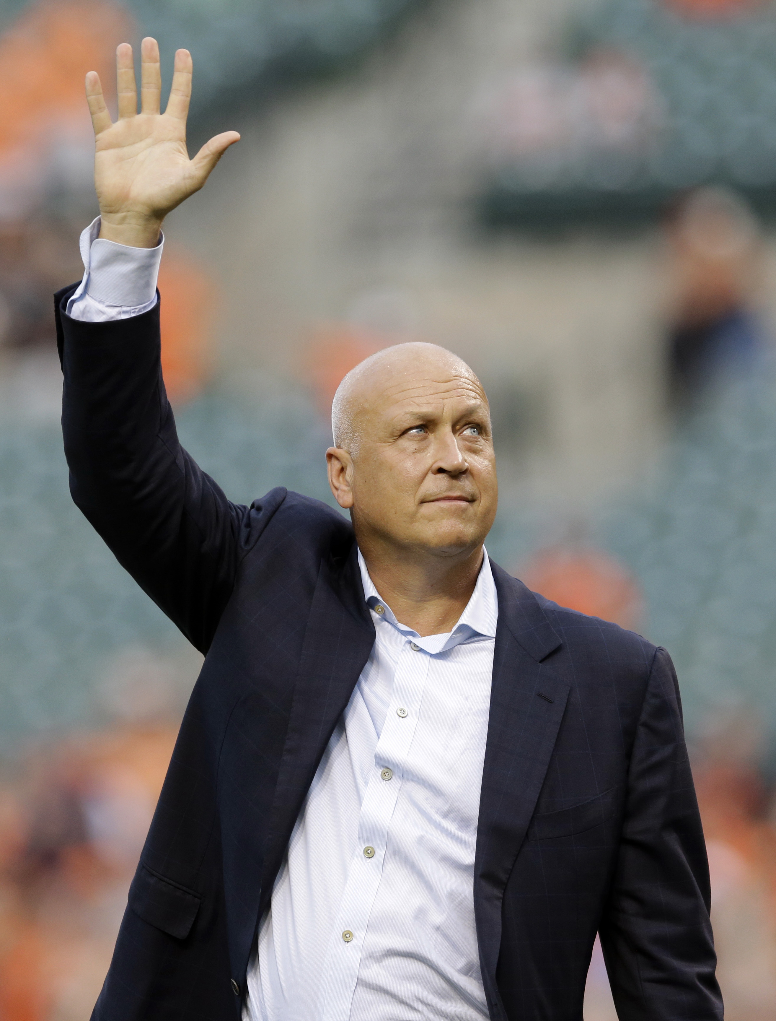 Former Baltimore Oriole Cal Ripken, Jr., acknowledges fans before throwing out the ceremonial first pitch to mark the twentieth anniversary of his streak of 2,131 straight games before a baseball game between the Orioles and the Tampa Bay Rays, Tuesday, S