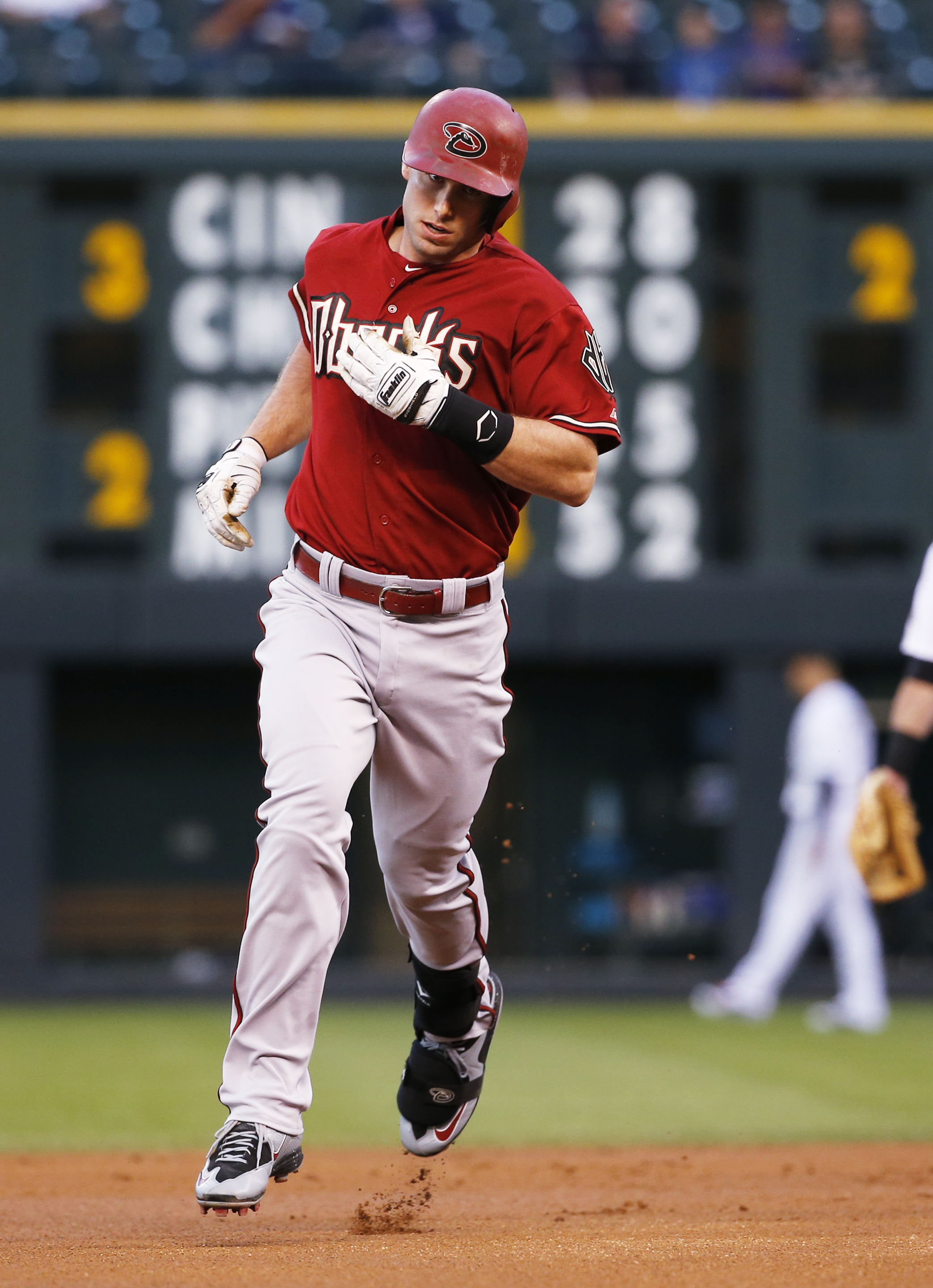 Arizona Diamondbacks' Paul Goldschmidt rounds the bases after hitting a solo home run off Colorado Rockies starting pitcher Kyle Kendrick during the first inning of the second game of a baseball doubleheader Tuesday, Sept. 1, 2015, in Denver. (AP Photo/Ja