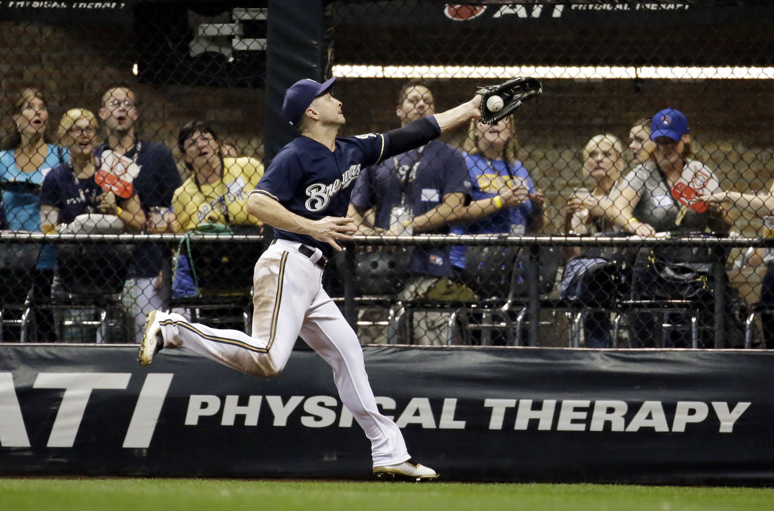 Milwaukee Brewers right fielder Ryan Braun makes a running catch on a ball hit by Pittsburgh Pirates' Francisco Cervelli during the third inning of a baseball game Tuesday, Sept. 1, 2015, in Milwaukee. (AP Photo/Morry Gash)