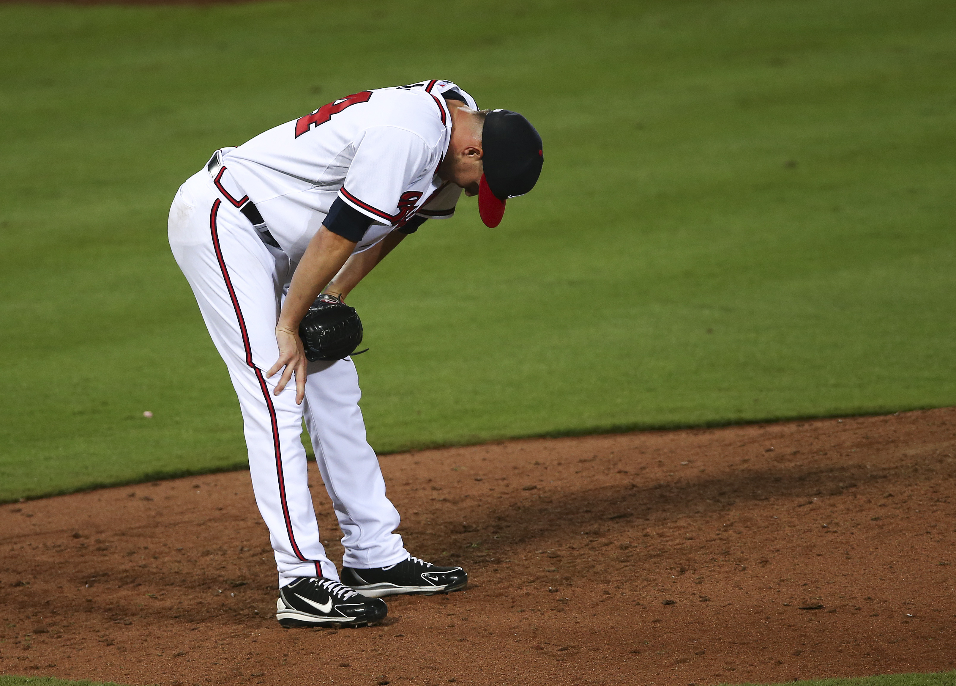 Atlanta Braves relief pitcher Ryan Kelly (64) reacts after giving up a three-run home run to Miami Marlins' Justin Bour in the seventh inning of a baseball game Tuesday, Sept. 1, 2015, in Atlanta. (AP Photo/John Bazemore)
