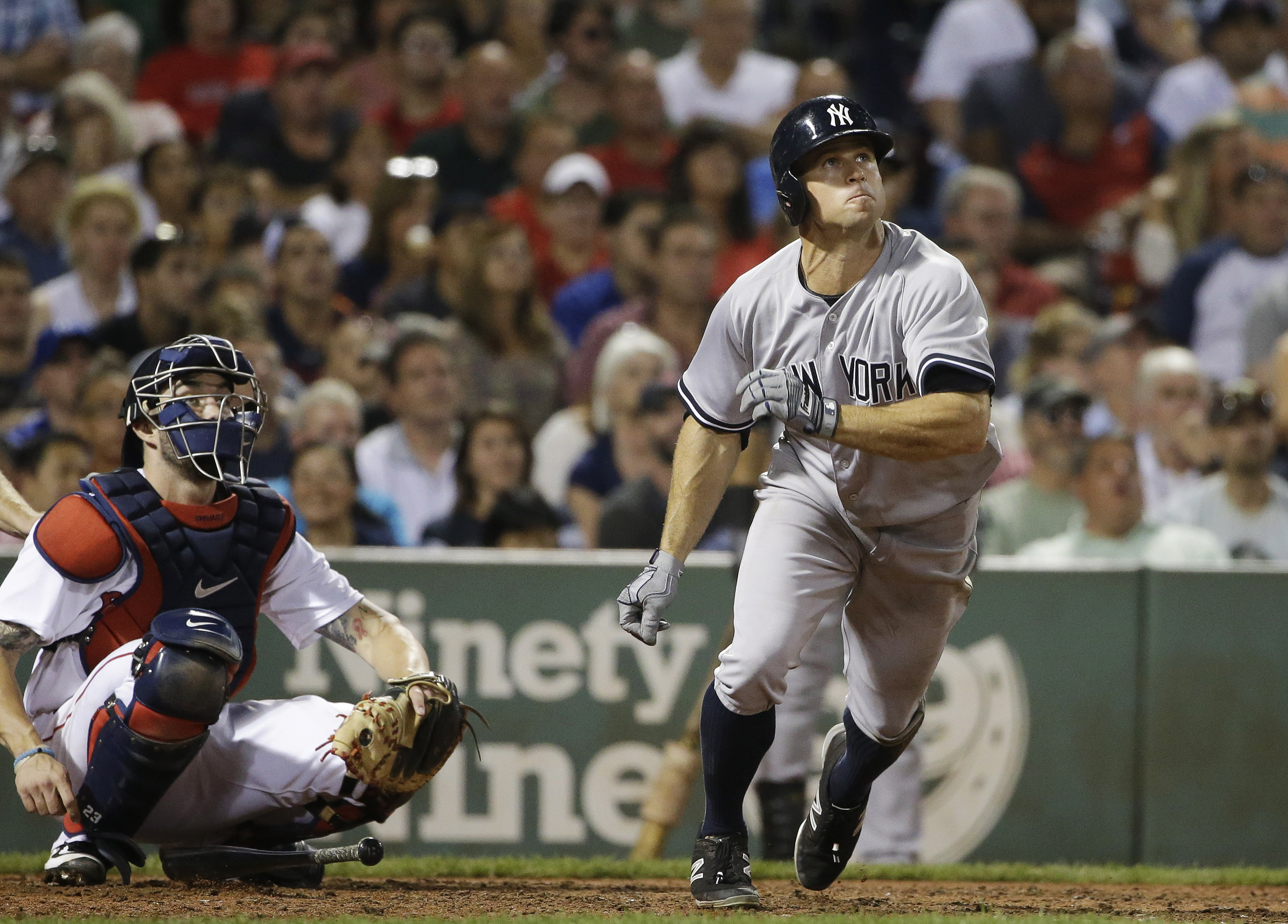 New York Yankees' Brett Gardner watches the flight of his home run as Boston Red Sox catcher Blake Swihart, left, does as well, during the eighth inning of a baseball game, Tuesday, Sept. 1, 2015, at Fenway Park, in Boston. (AP Photo/Steven Senne)