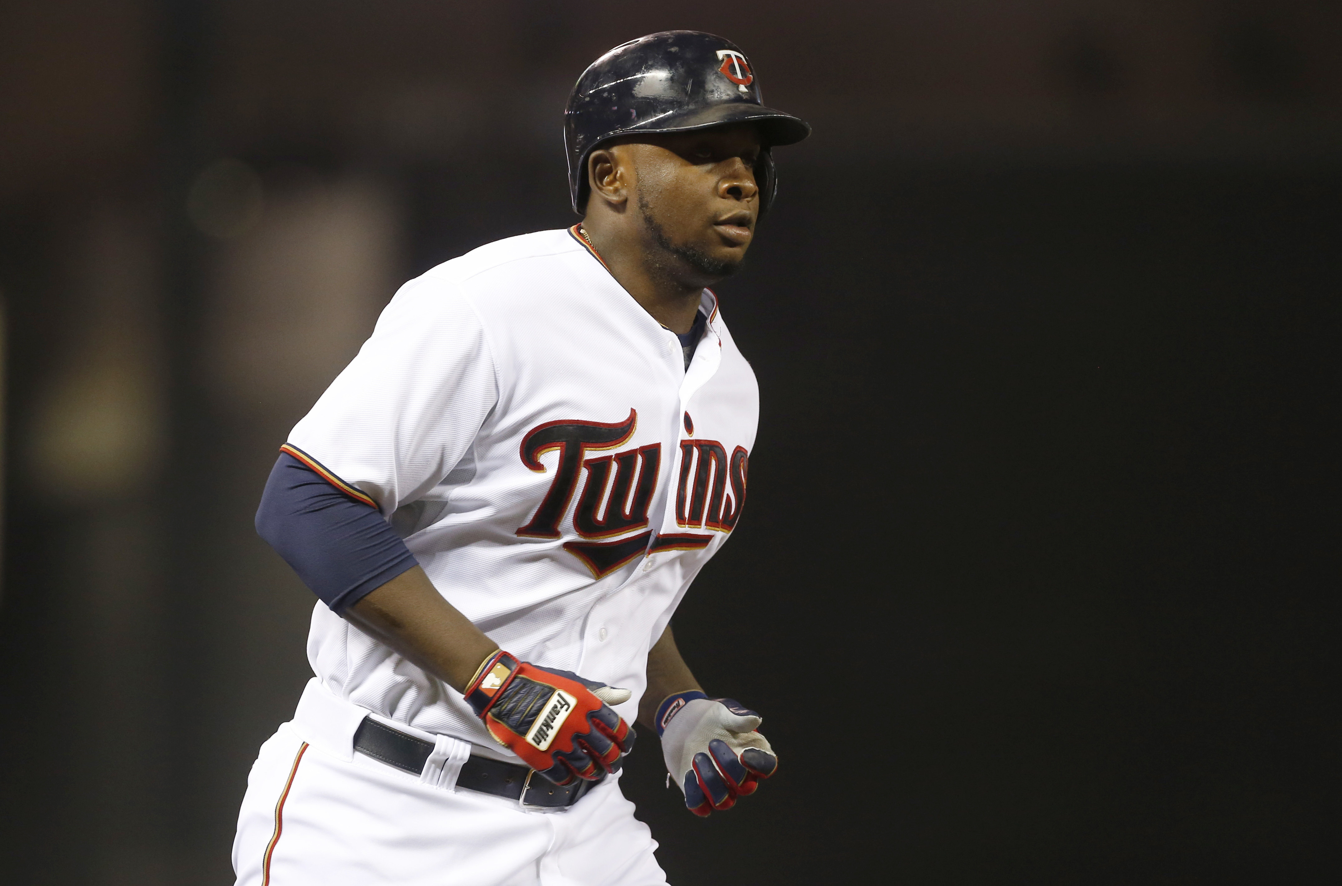 Minnesota Twins' Miguel Sano heads for home on a solo home run off Chicago White Sox relief pitcher Nate Jones during the eighth inning of a baseball game, Tuesday, Sept. 1, 2015, in Minneapolis. The Twins won 8-6. (AP Photo/Jim Mone)