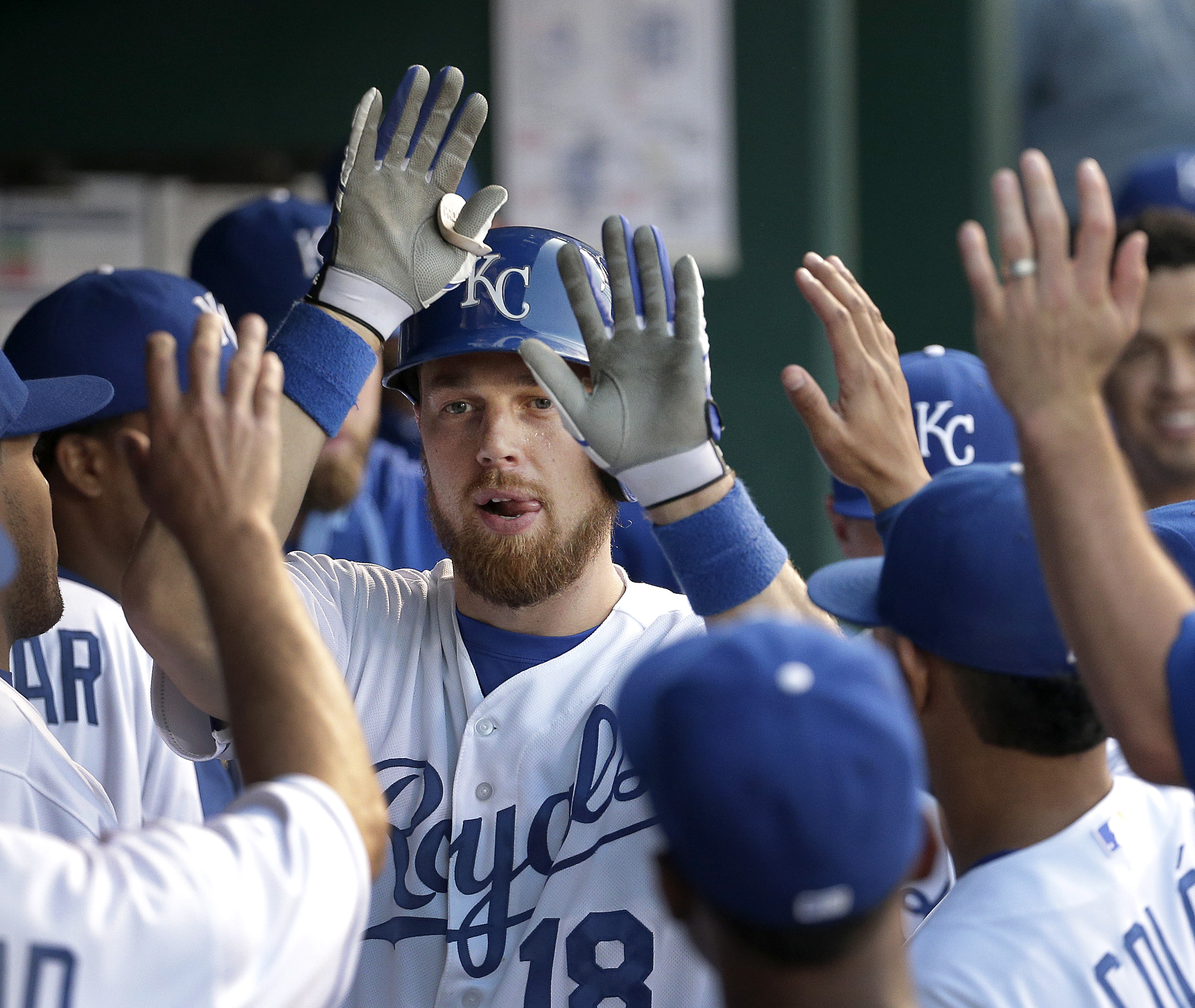 Kansas City Royals' Ben Zobrist celebrates in the dugout after hitting a solo home run during the first inning of a baseball game against the Detroit Tigers Wednesday, Sept. 2, 2015, in Kansas City, Mo. (AP Photo/Charlie Riedel)