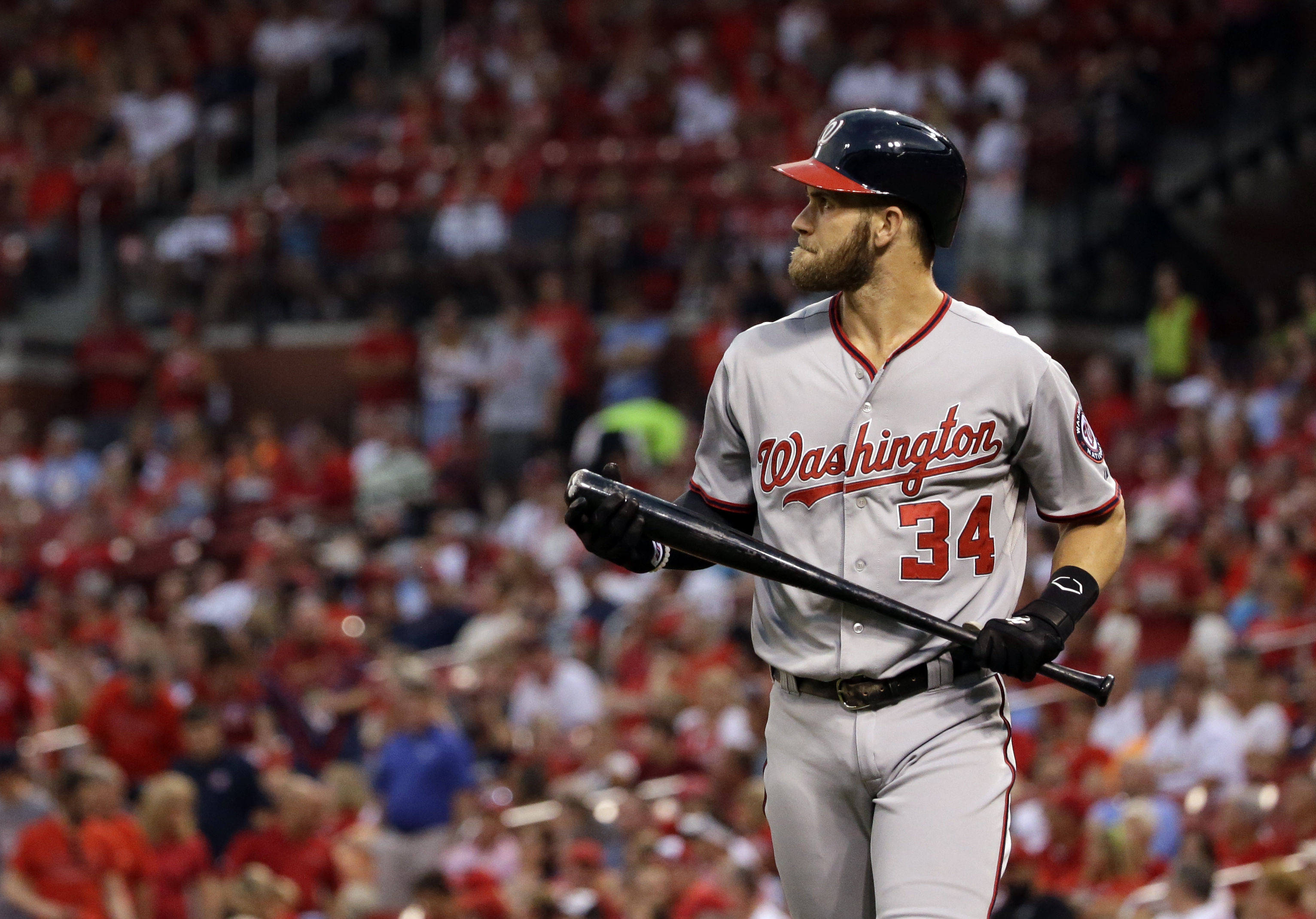 Washington Nationals' Bryce Harper heads back to the dugout after striking out during the first inning of a baseball game against the St. Louis Cardinals Wednesday, Sept. 2, 2015, in St. Louis. (AP Photo/Jeff Roberson)