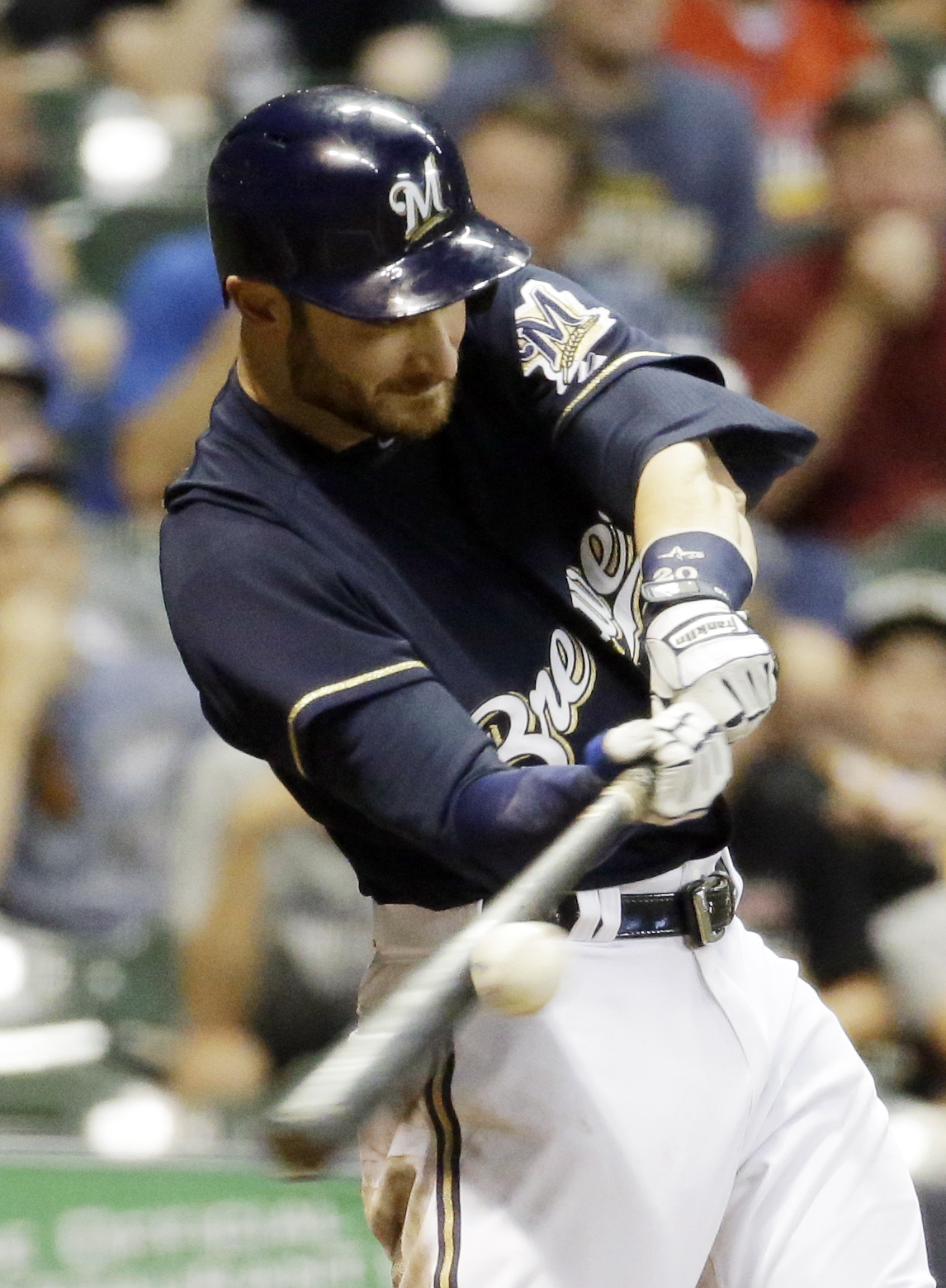 Milwaukee Brewers' Jonathan Lucroy hits a two-run scoring single during the fourth inning of a baseball game against the Pittsburgh Pirates Wednesday, Sept. 2, 2015, in Milwaukee. (AP Photo/Morry Gash)