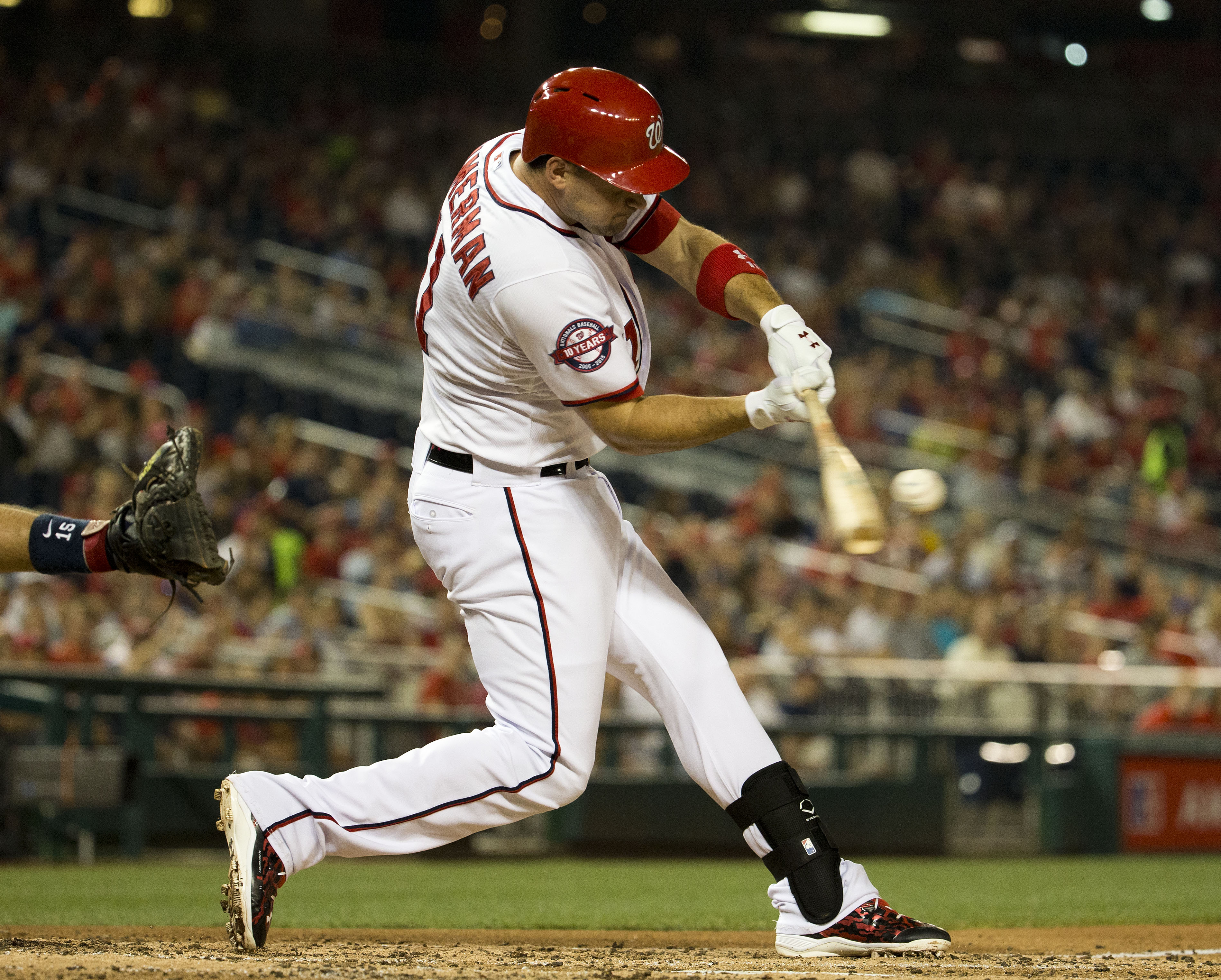 Washington Nationals' Ryan Zimmerman hits a two-run single against Atlanta Braves relief pitcher Andrew McKirahan during the third inning of a baseball game at Nationals Park, Thursday, Sept. 3, 2015, in Washington. Nationals' Jayson Werth and Anthony Ren
