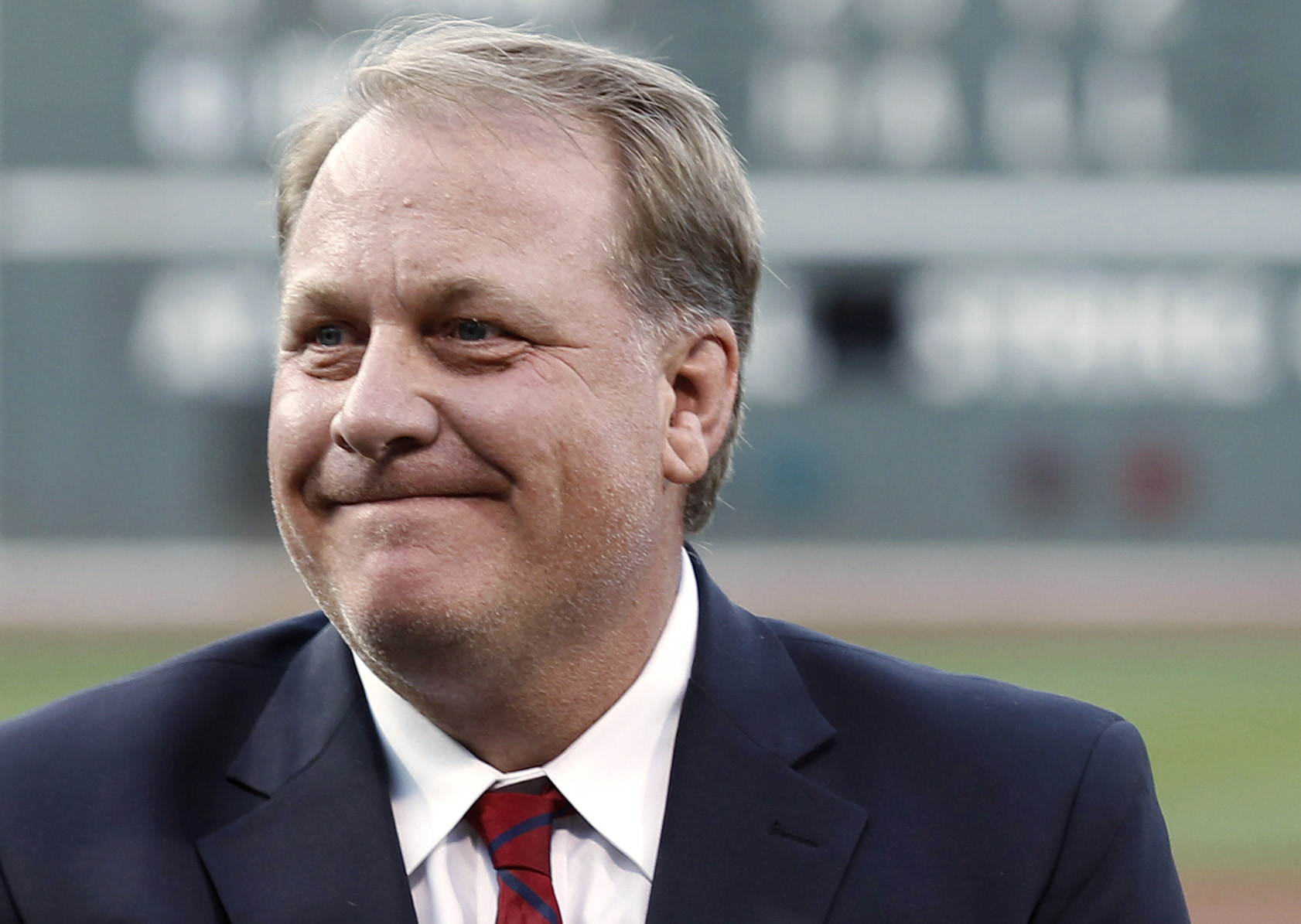 FILE In this Aug. 3, 2012, file photo, former Boston Red Sox pitcher Curt Schilling reacts after being introduced as a new member of the Boston Red Sox Hall of Fame, at Fenway Park in Boston. ESPN says commentator Schilling won't appear on the air for the