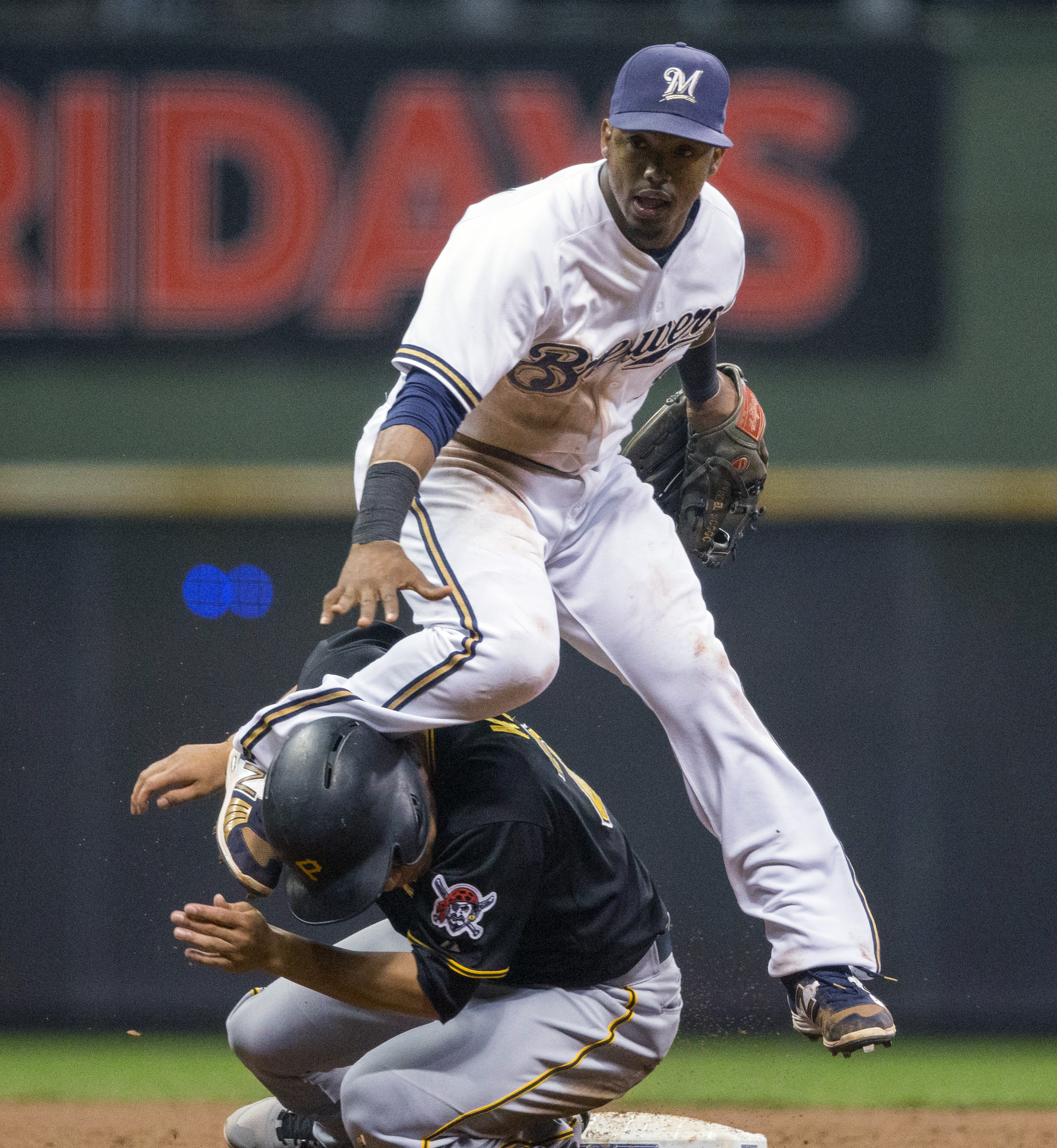 Milwaukee Brewers' Jean Segura gets the force out at second base on Pittsburgh Pirates' Jung Ho Kang during the seventh inning of a baseball game, Thursday, Sept. 3, 2015, in Milwaukee. (AP Photo/Tom Lynn)