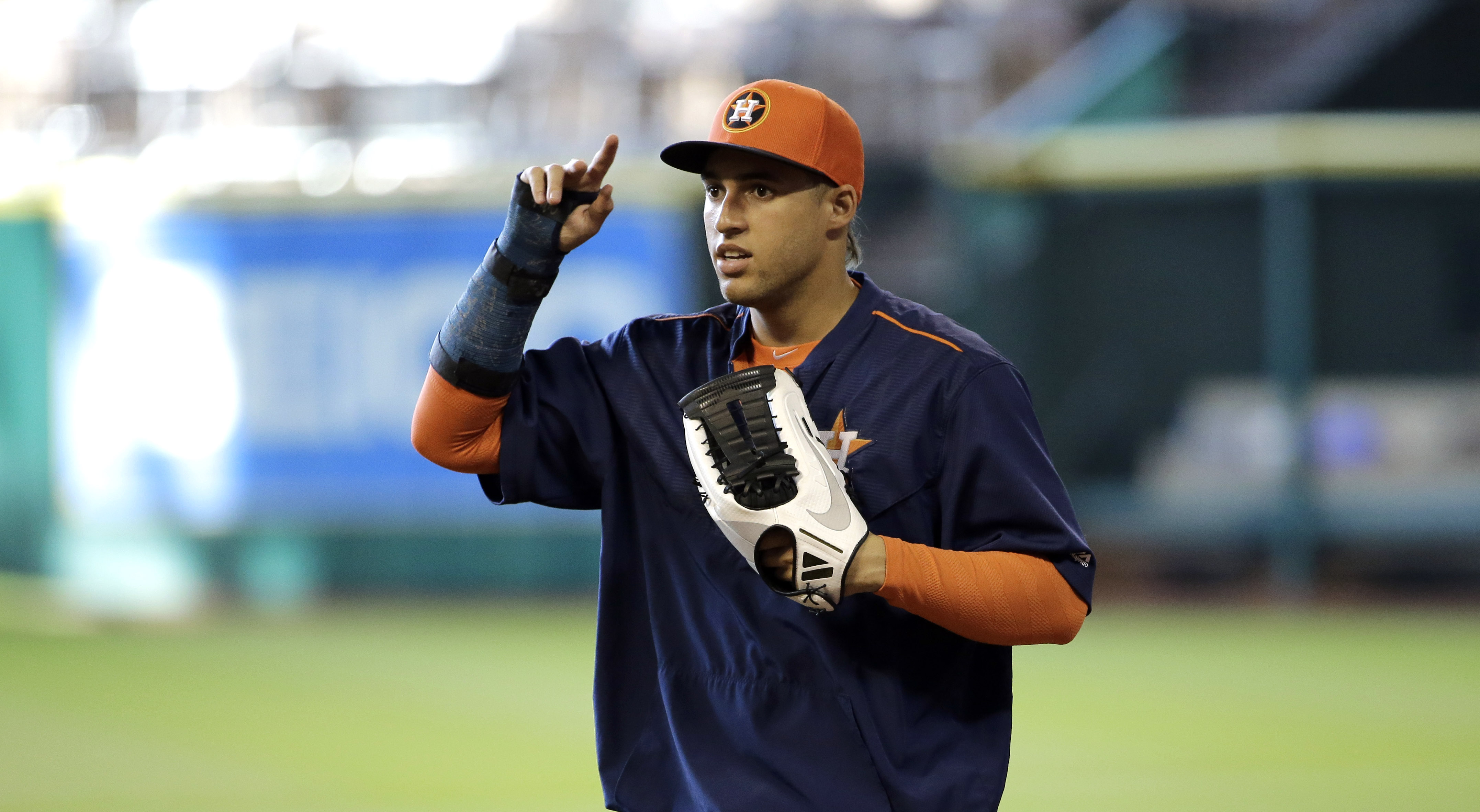 Houston Astros' George Springer fields ground ball while wearing a cast during batting practice before a baseball game against the Arizona Diamondbacks Friday, July 31, 2015, in Houston. Springer is out with fractured right wrist. (AP Photo/David J. Phill