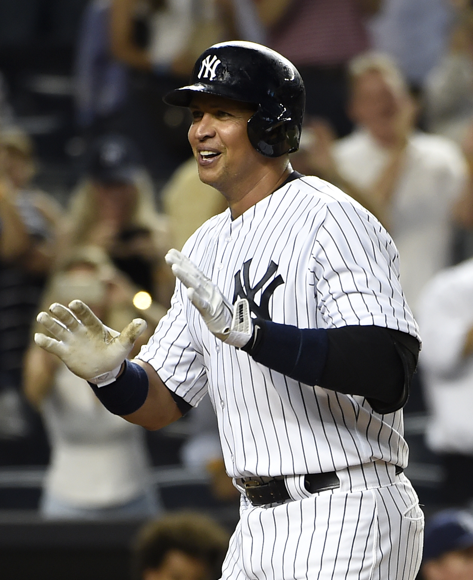 New York Yankees designated hitter Alex Rodriguez smiles as he runs towards home plate after hitting two-run home run off of Tampa Bay Rays starting pitcher Jake Odorizzi in the second inning of a baseball game at Yankee Stadium on Friday, Sept. 4, 2015,