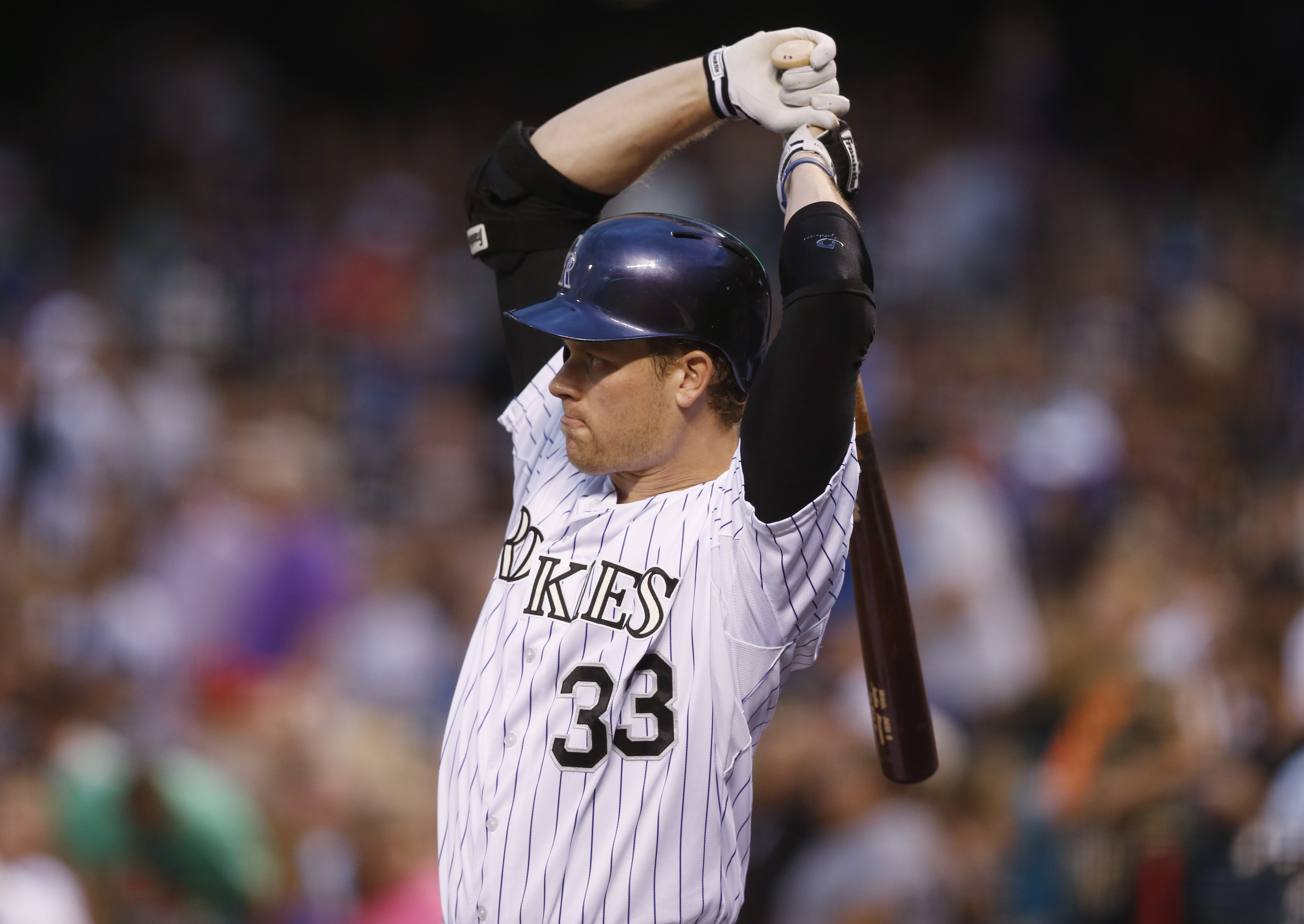 Colorado Rockies' Justin Morneau waits in the on-deck circle to bat against the San Francisco Giants in the first inning of a baseball game Friday, Sept.. 4, 2015, in Denver. Morneau was making his first appearance on the field for the Rockies since being