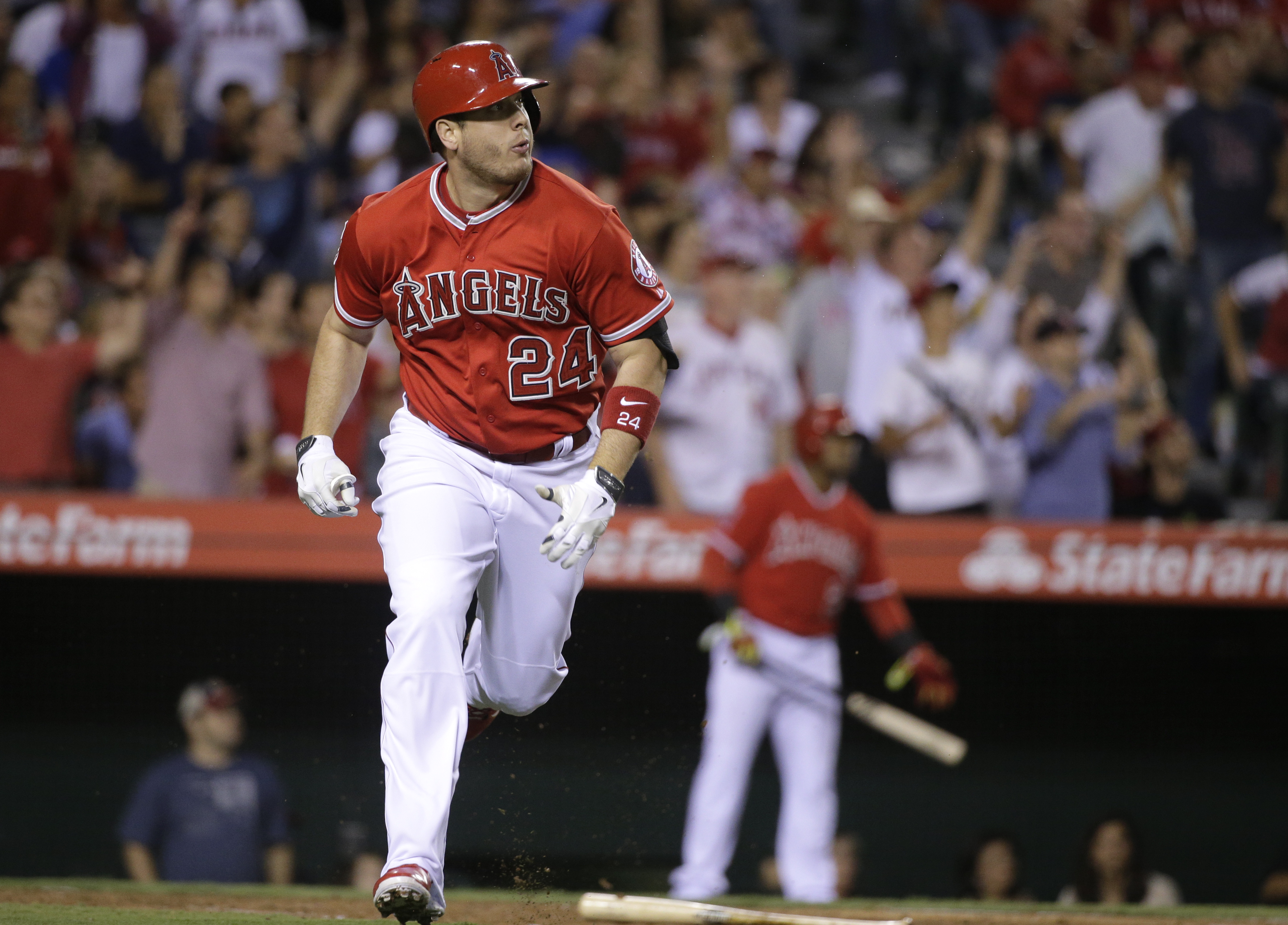 Los Angeles Angels' C.J. Cron watches his two-run double during the seventh inning of a baseball game against the Texas Rangers, Friday, Sept. 4, 2015, in Anaheim, Calif. (AP Photo/Jae C. Hong)