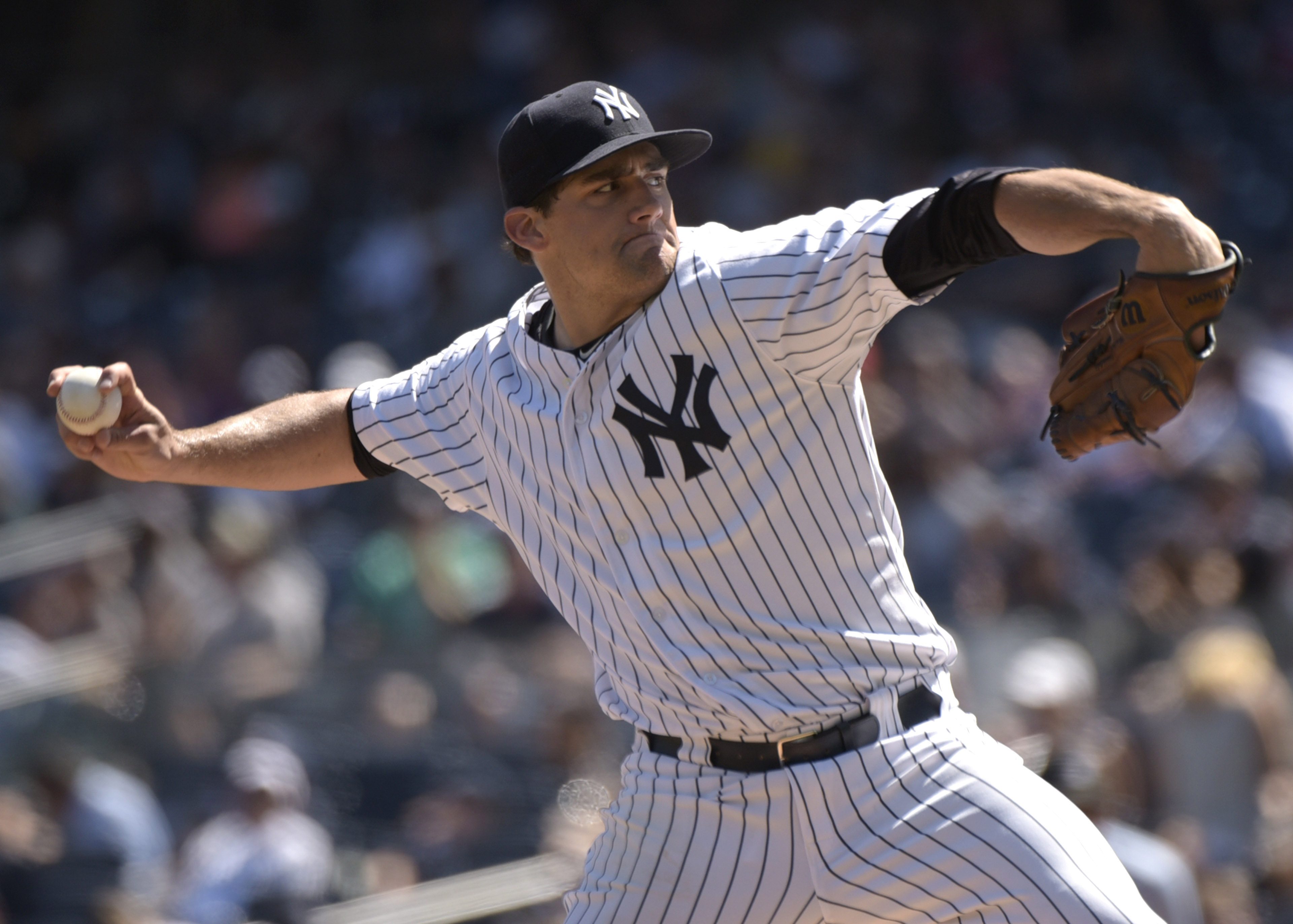 New York Yankees pitcher Nathan Eovaldi delivers the ball to the Tampa Bay Rays  during the first inning of a baseball game Saturday, Sept. 5, 2015, at Yankee Stadium in New York. (AP Photo/Bill Kostroun)