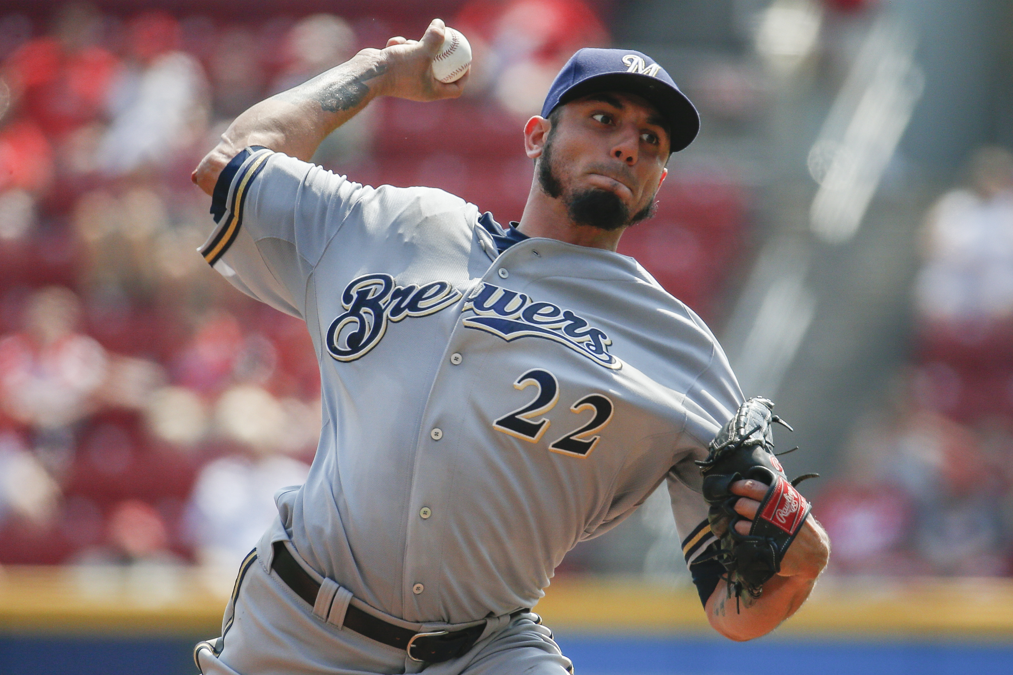 Milwaukee Brewers starting pitcher Matt Garza (22) throws in the inning first in the first game of a baseball doubleheader against the Cincinnati Reds, Saturday, Sept. 5, 2015, in Cincinnati. (AP Photo/John Minchillo)