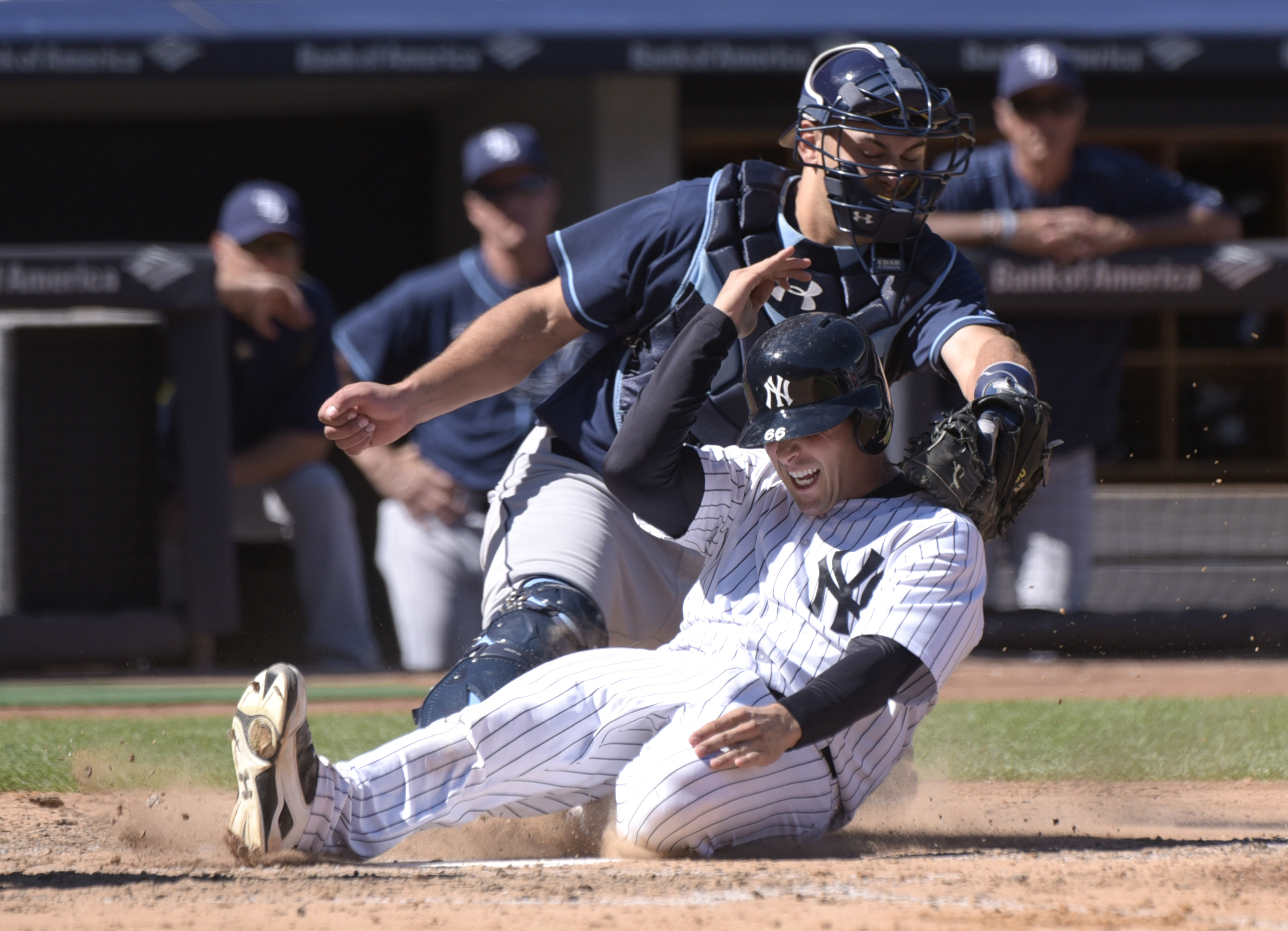 New York Yankees' John Ryan Murphy (66) scores on a double by Didi Gregorius ahead of the tag by Tampa Bay Rays catcher Luke Maile during the fifth inning of a baseball game Saturday, Sept. 5, 2015, at Yankee Stadium in New York. (AP Photo/Bill Kostroun)