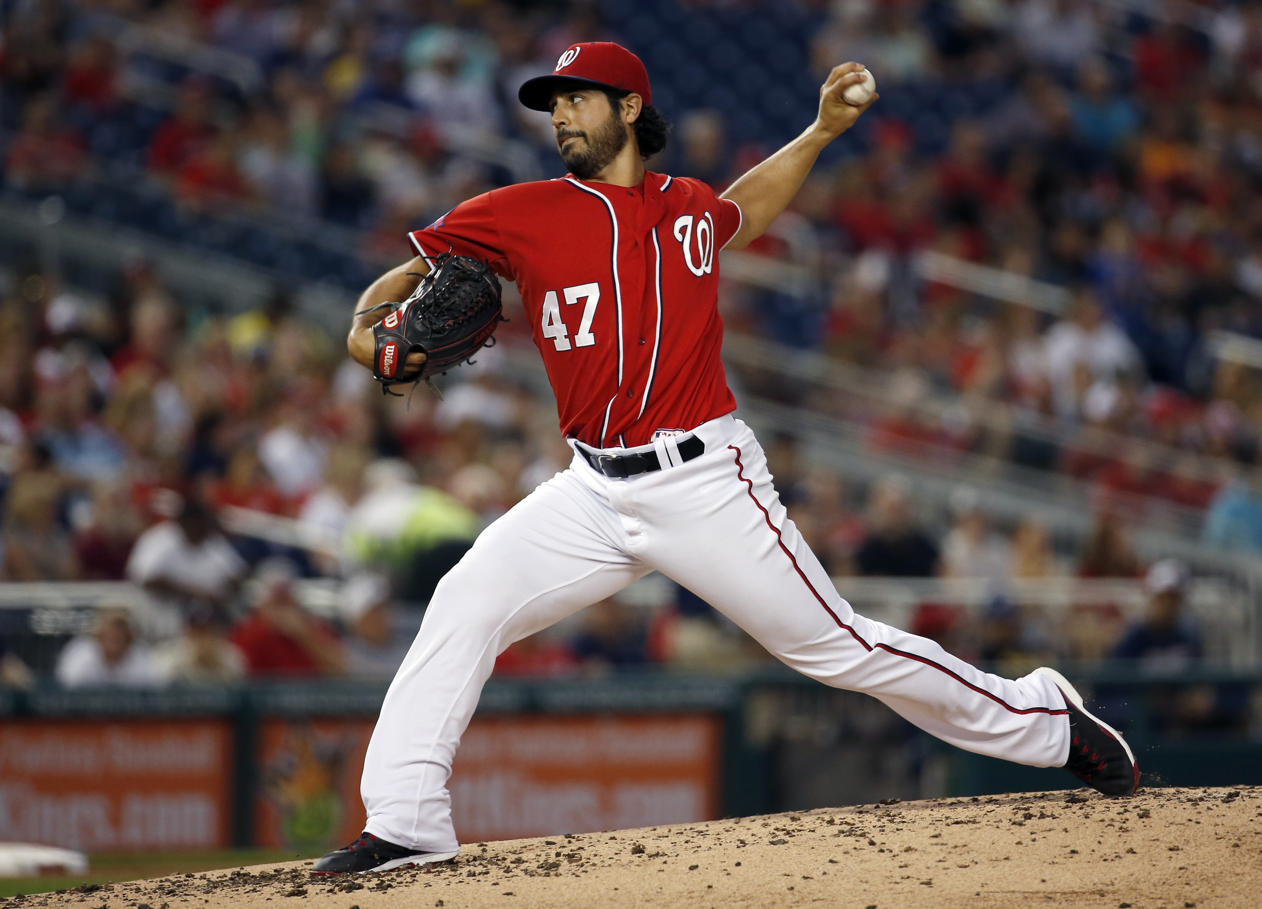Washington Nationals starting pitcher Gio Gonzalez throws during the third inning of a baseball game against the Atlanta Braves at Nationals Park, Saturday, Sept. 5, 2015, in Washington. (AP Photo/Alex Brandon)