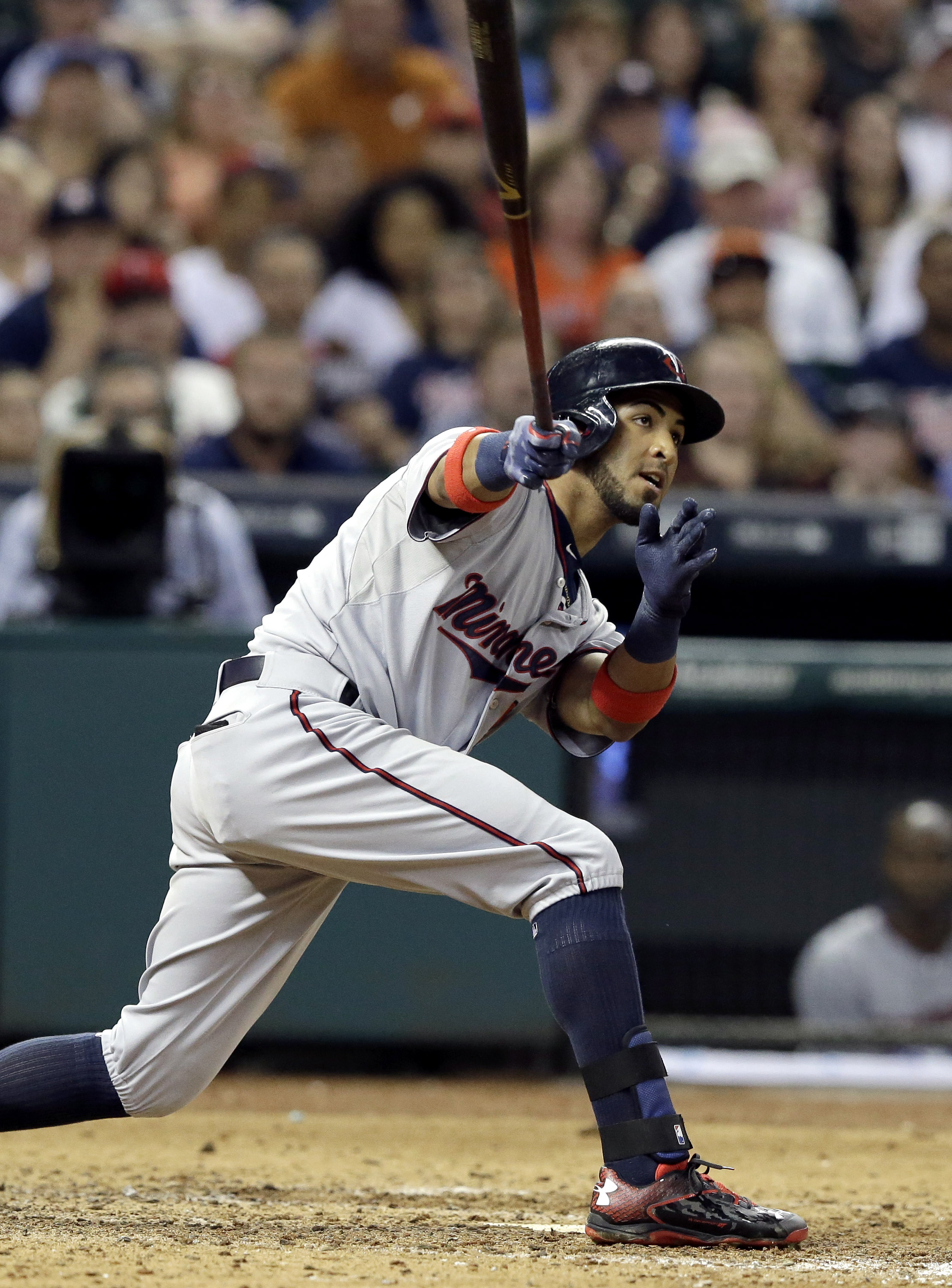 Minnesota Twins' Eddie Rosario watch as the ball goes long to right field for a two-run triple against the Houston Astros in the ninth inning of a baseball game Saturday, Sept. 5, 2015, in Houston. (AP Photo/Pat Sullivan)