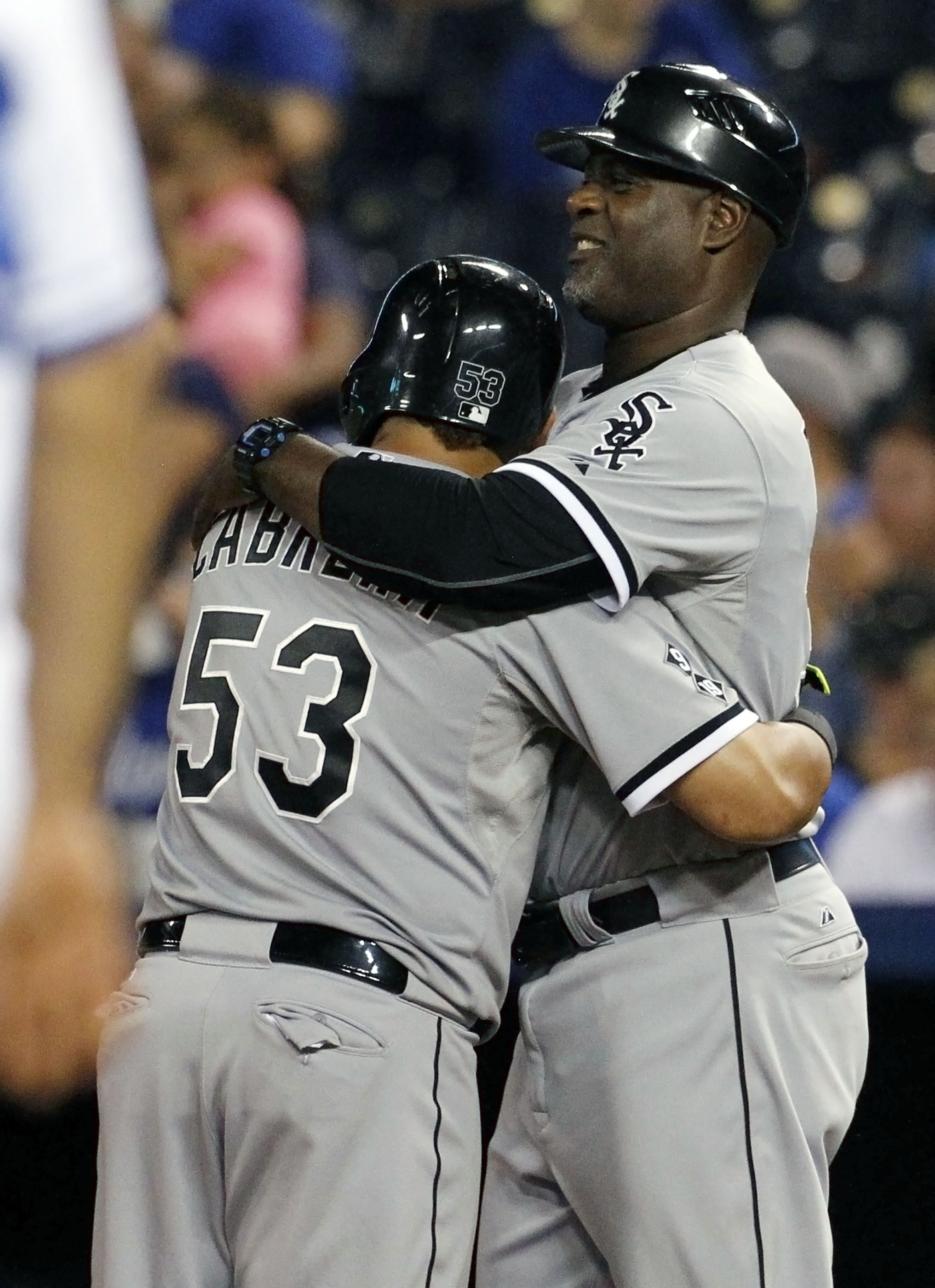 Chicago White Sox' Melky Cabrera (53) gets a hug from first base coach Daryl Boston (32) after hitting an RBI single in the ninth inning of a baseball game against the Kansas City Royals at Kauffman Stadium in Kansas City, Mo., Saturday, Sept. 5, 2015. Th