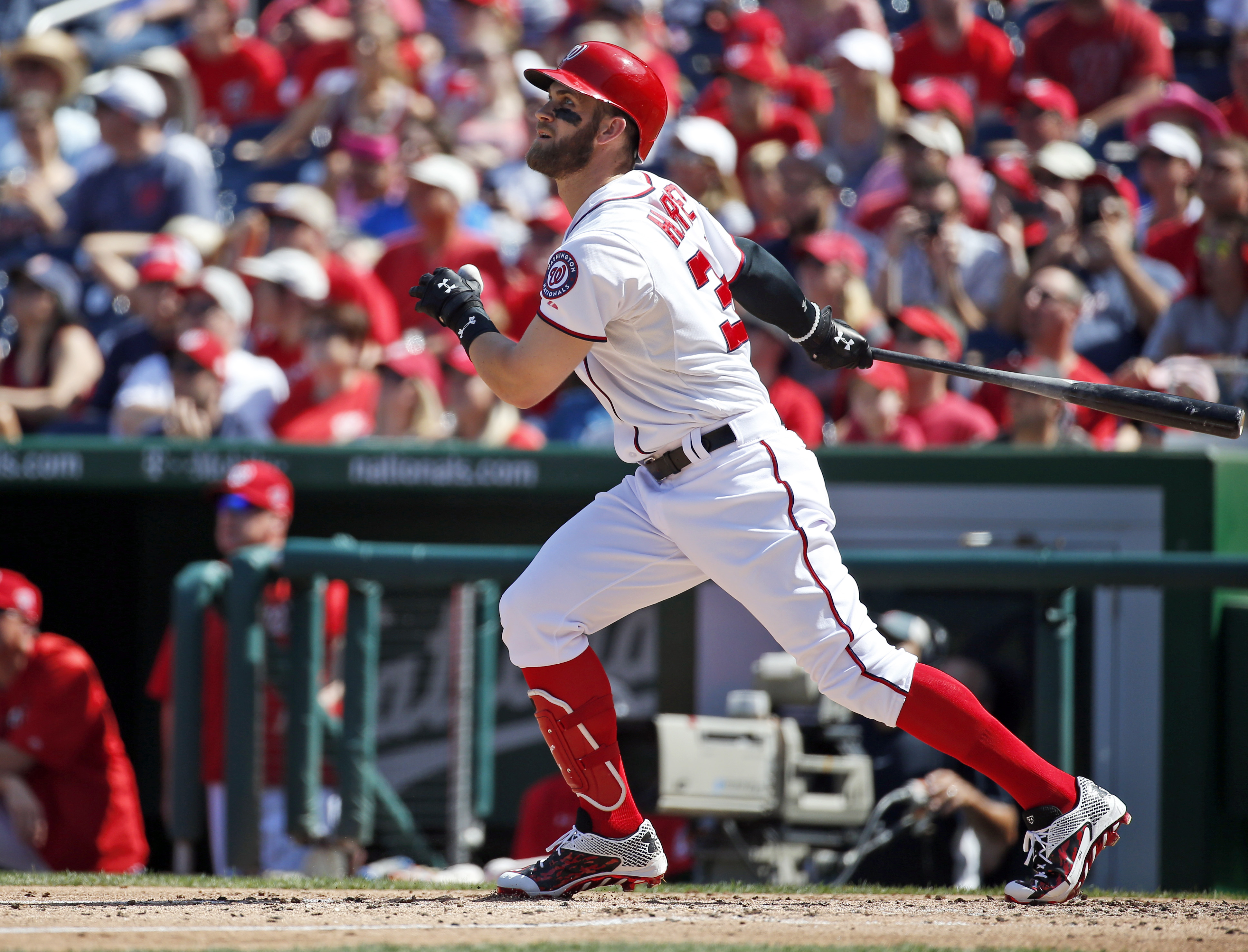 Washington Nationals' Bryce Harper watches his solo home run during the third inning of a baseball game against the Atlanta Braves at Nationals Park, Sunday, Sept. 6, 2015, in Washington. (AP Photo/Alex Brandon)