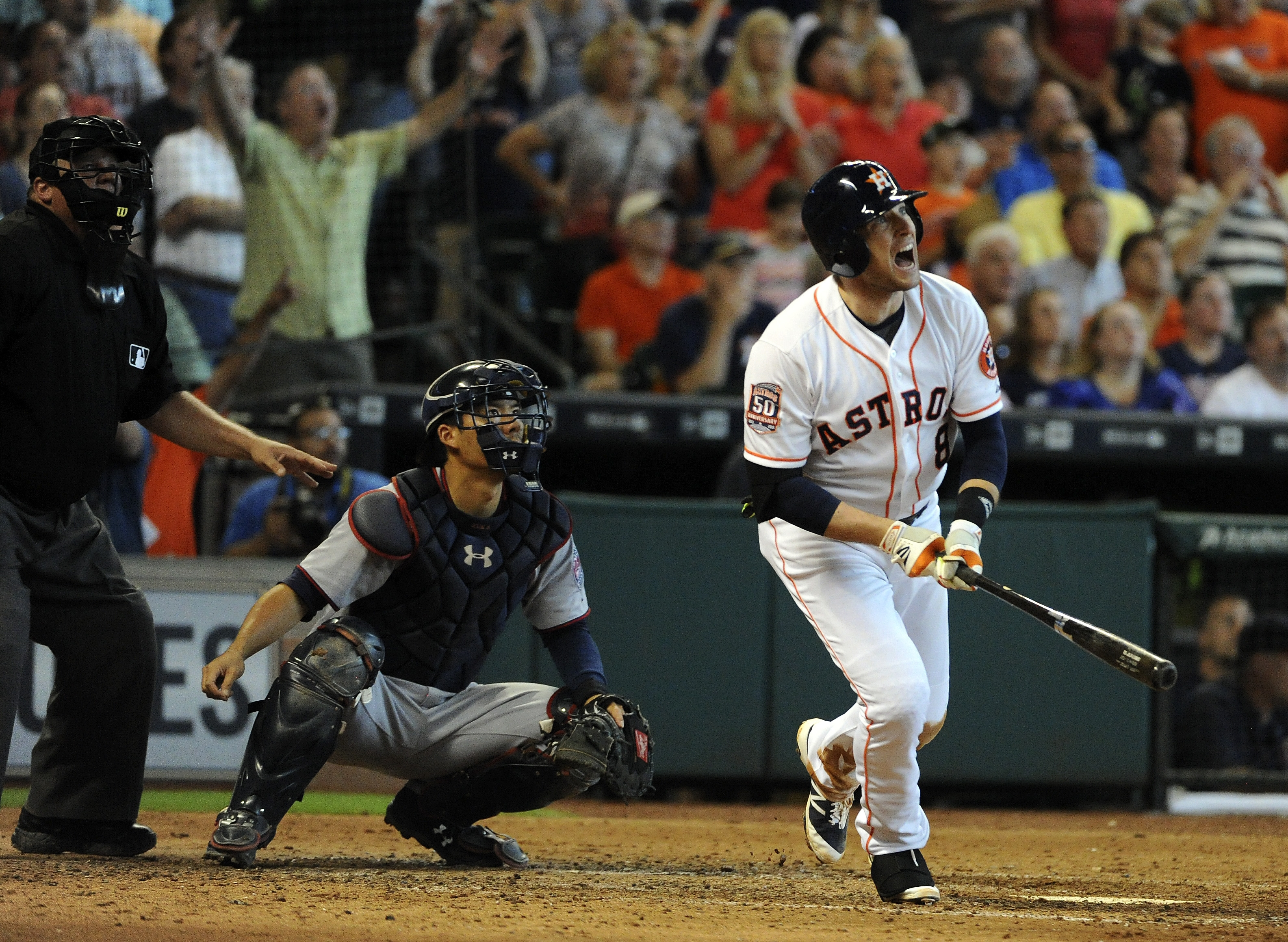 Houston Astros' Jed Lowrie (8) watches his grand slam in the seventh inning of a baseball game against the Minnesota Twins, Sunday, Sept. 6, 2015, in Houston. (AP Photo/Eric Christian Smith)