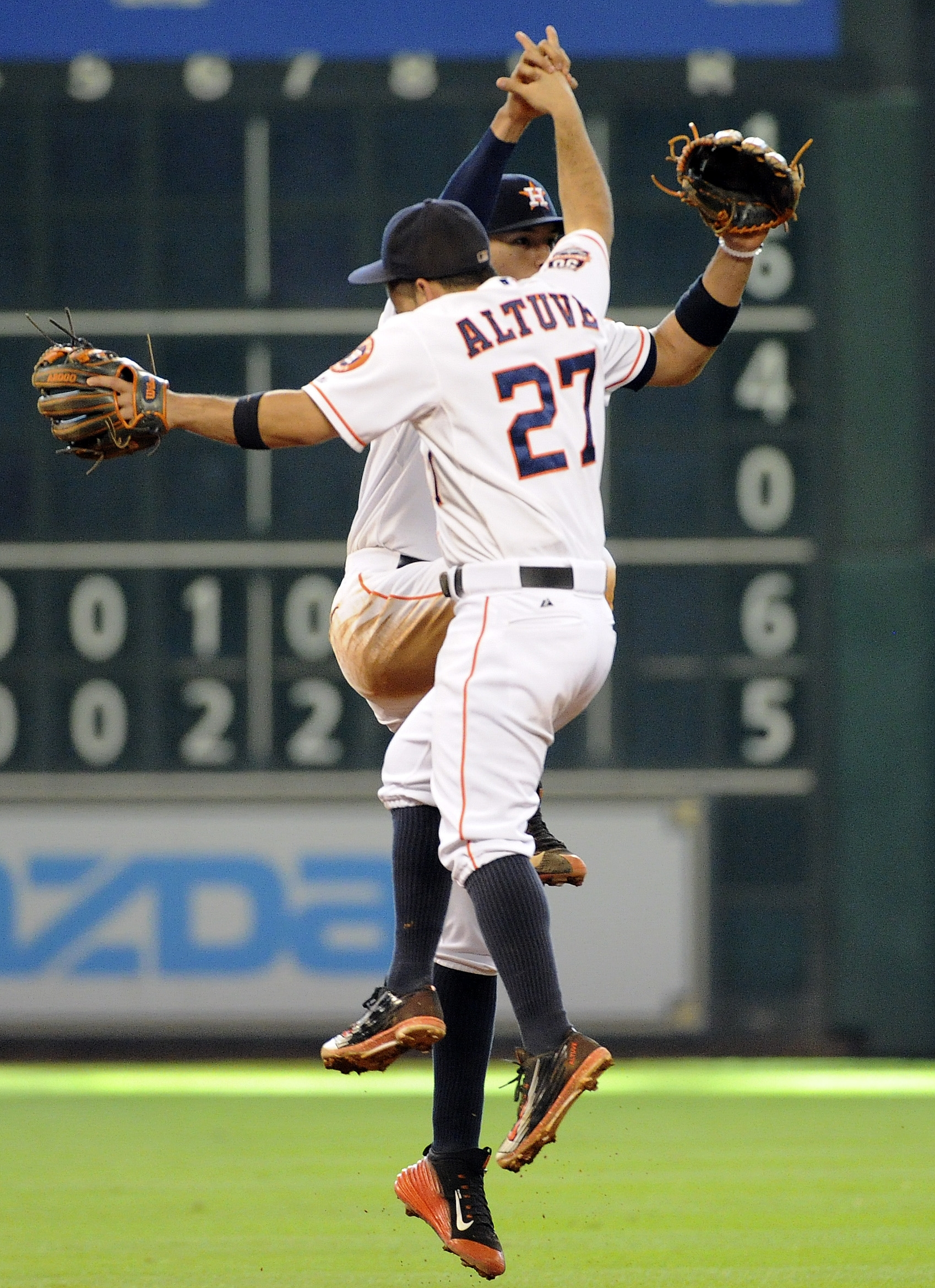 Houston Astros' Jose Altuve (27) and Carlos Correa celebrate the Astros' 8-5 victory over the Minnesota Twins in a baseball game, Sunday, Sept. 6, 2015, in Houston. (AP Photo/Eric Christian Smith)