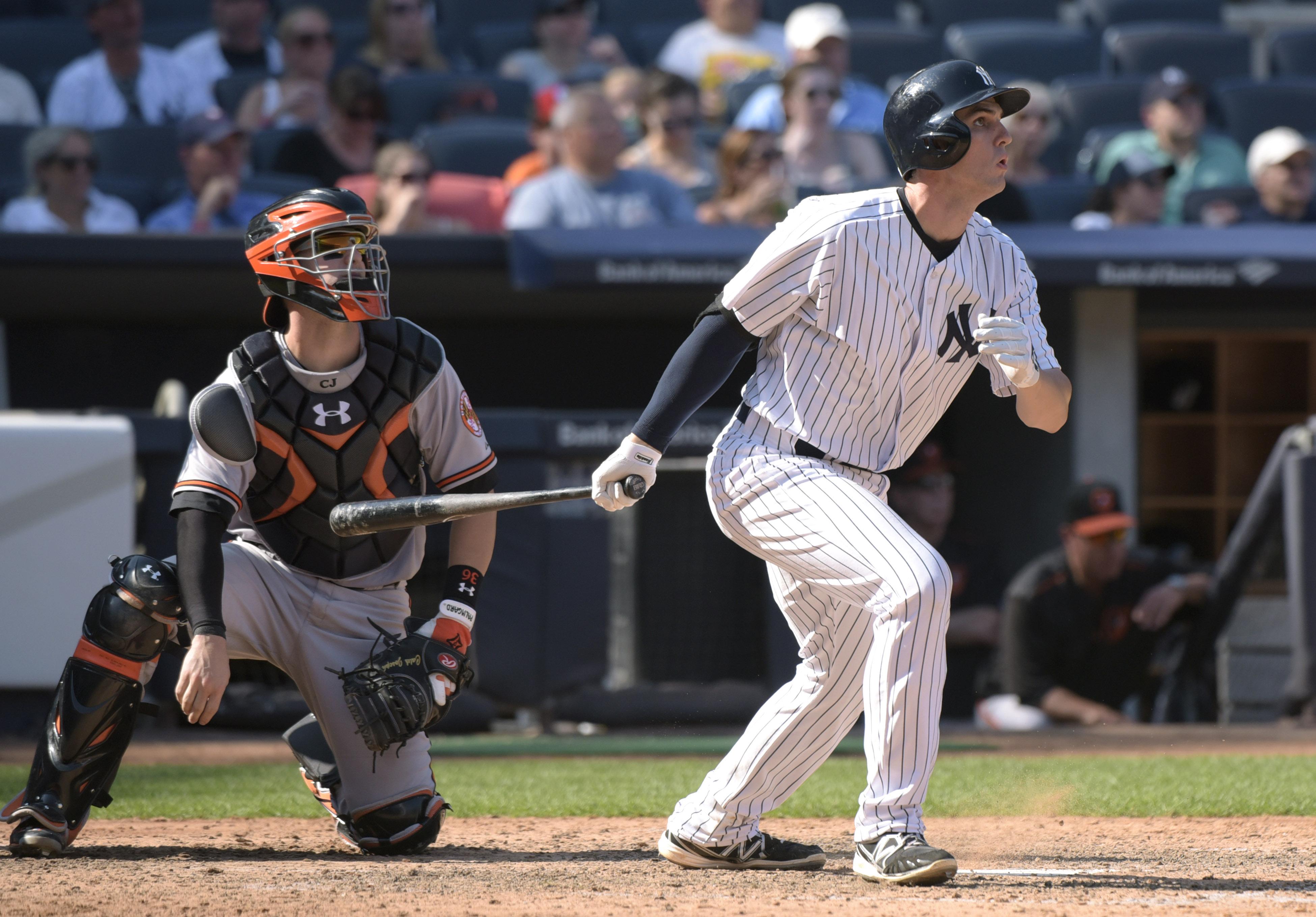 New York Yankees' Greg Bird, right, hits a three-run home run as Baltimore Orioles catcher Caleb Joseph, left, looks on during the seventh inning of a baseball game Monday, Sept. 7, 2015, at Yankee Stadium in New York. (AP Photo/Bill Kostroun)